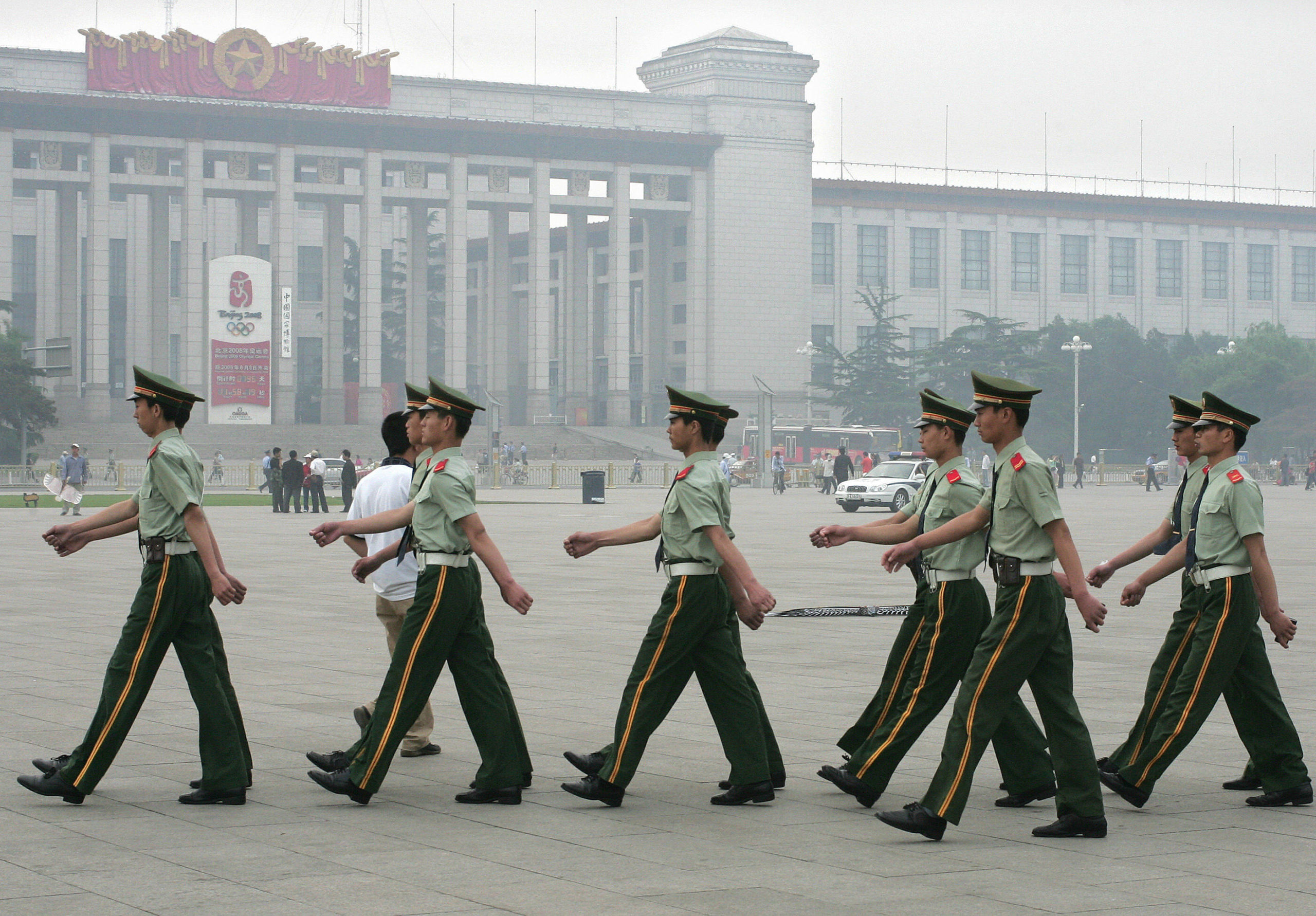 Paramilitary police march on Tiananmen Square, 04 June 2006. (Photo by FREDERIC J. BROWN/AFP via Getty Images)
