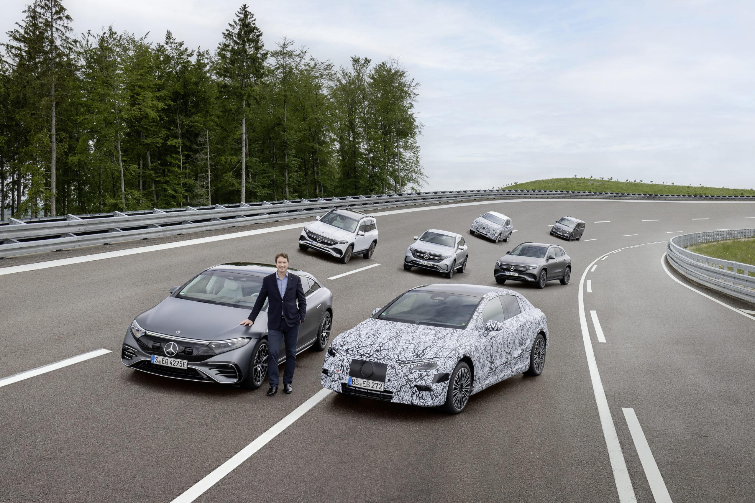 Mercedes-Benz CEO Ola Källenius stands beside a fleet of electric vehicles. (Mercedes-Benz)