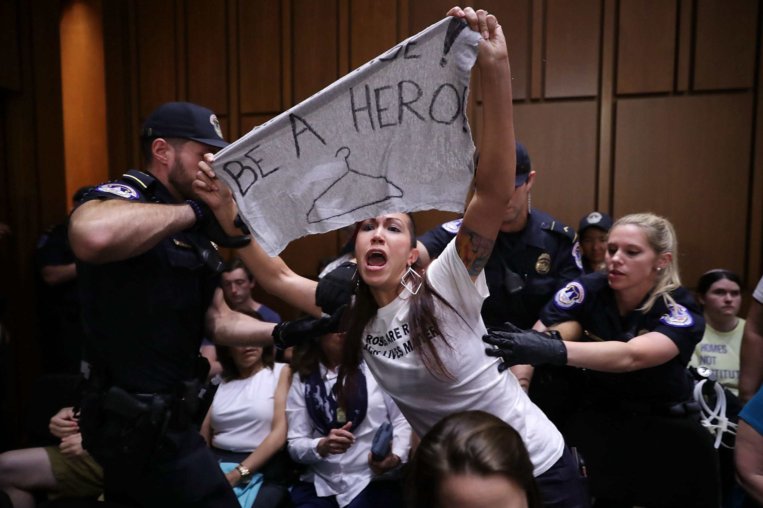WASHINGTON, DC - SEPTEMBER 05: U.S. Capitol Police remove a protester from the hearing room during the second day of Supreme Court nominee Judge Brett Kavanaugh's confirmation hearing before the Senate Judiciary Committee on Capitol Hill September 5, 2018 in Washington, DC. (Photo by Chip Somodevilla/Getty Images)