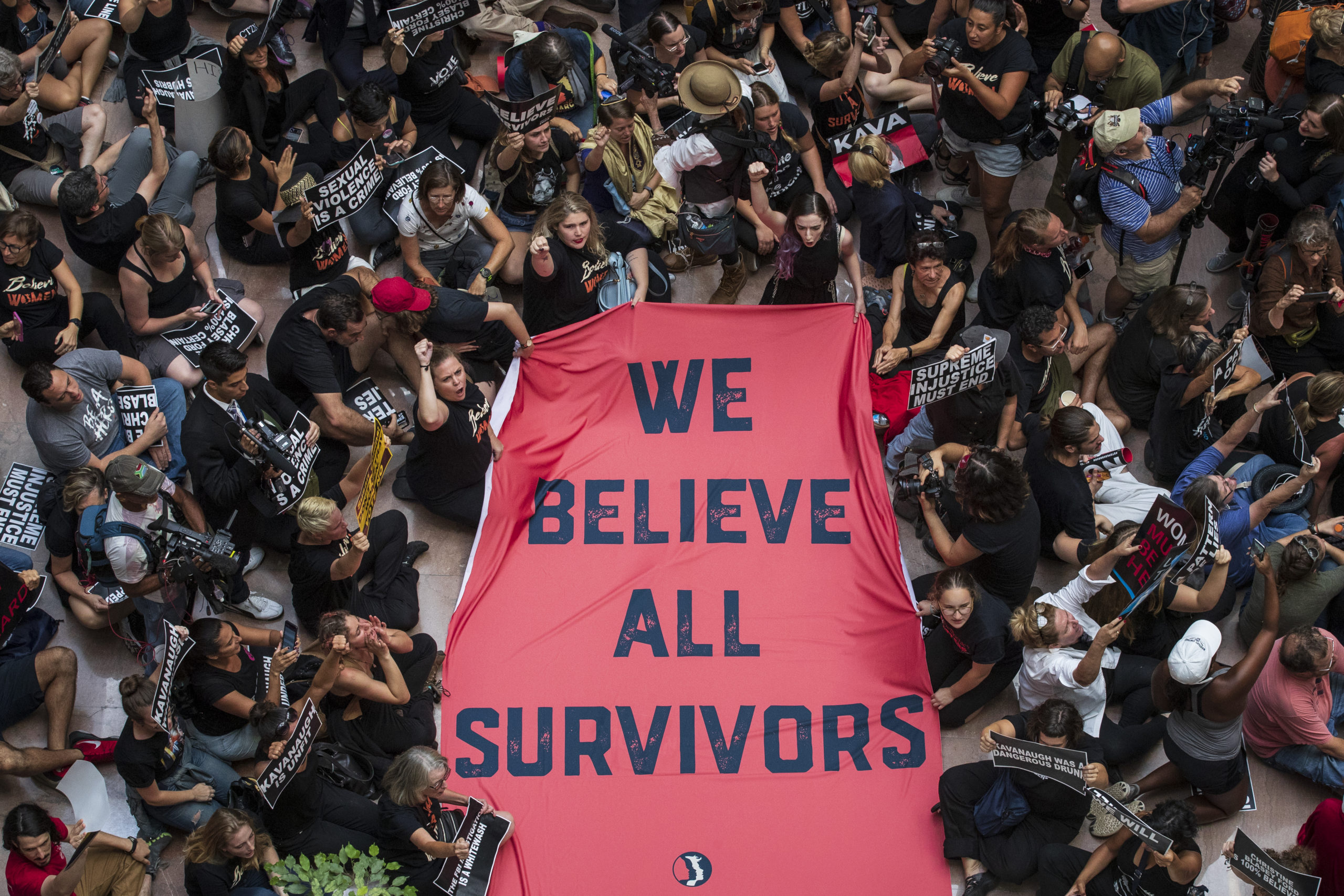 WASHINGTON, DC - OCTOBER 4: Protestors rally against Supreme Court nominee Judge Brett Kavanaugh in the atrium of the Hart Senate Office Building on Capitol Hill, October 4, 2018 in Washington, DC. (Photo by Drew Angerer/Getty Images)