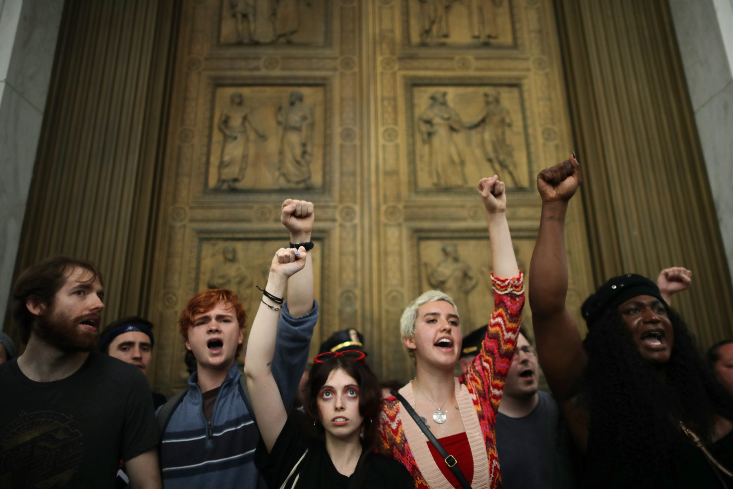 WASHINGTON, DC - OCTOBER 06: After overrunning police barricades, protesters chant as they block the doors to the U.S. Supreme Court while demonstrating against the confirmation of Associate Justice Brett Kavanaugh October 06, 2018 in Washington, DC. The protesters marched up to the doors of the court as Kavanaugh was inside taking his oath. (Photo by Chip Somodevilla/Getty Images)