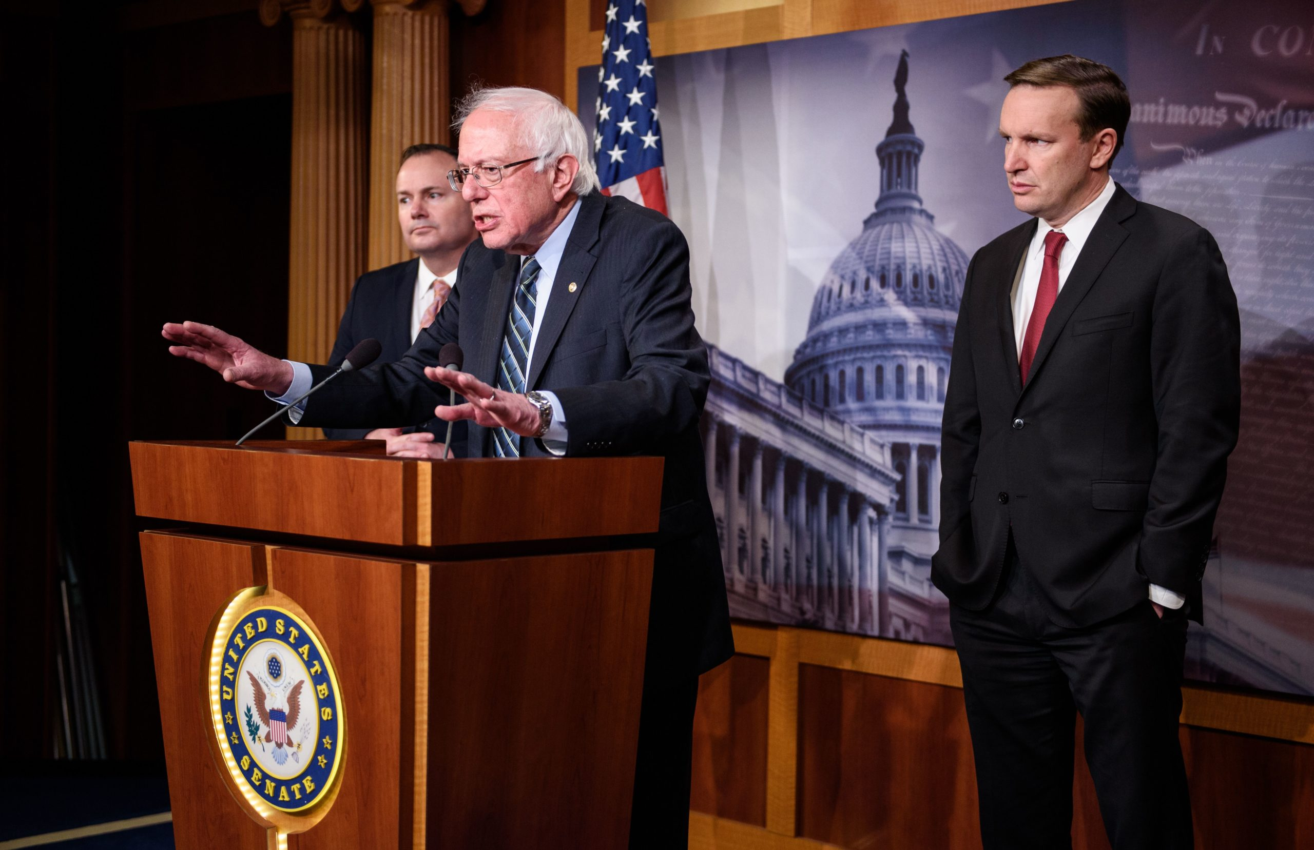 Sens. Bernie Sanders, Mike Lee and Chris Murphy speak after the Senate voted to withdraw support for Saudi Arabia's war in Yemen in December 2018. (MANDEL NGAN/AFP via Getty Images)