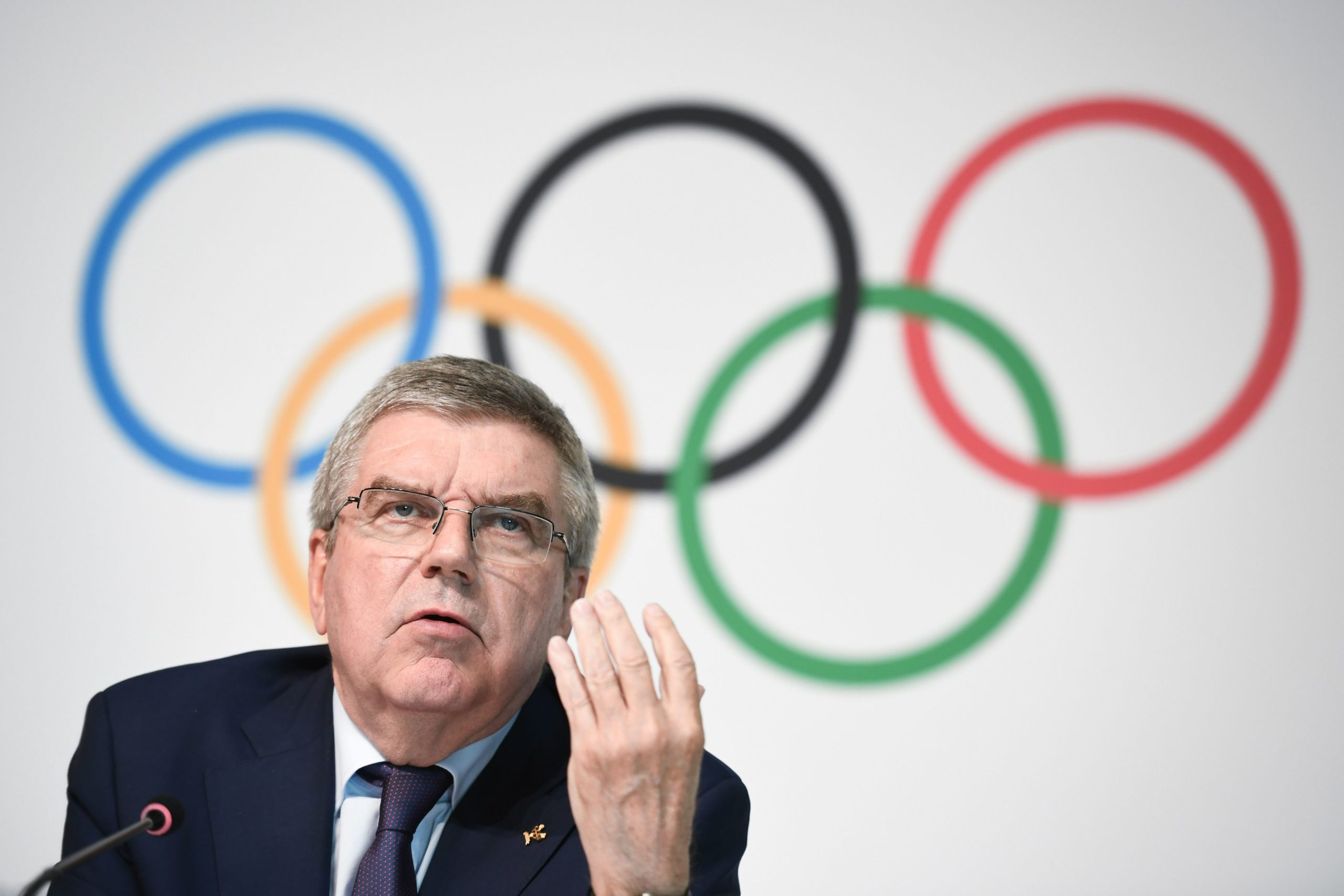International Olympic Committee (IOC) president Thomas Bach gestures as he speaks during a press conference following an IOC executive committee on boxing at the 2020 Olympic Games at the sports governing body's headquarters on May 22, 2019 in Lausanne. (Photo credit: FABRICE COFFRINI/AFP via Getty Images)