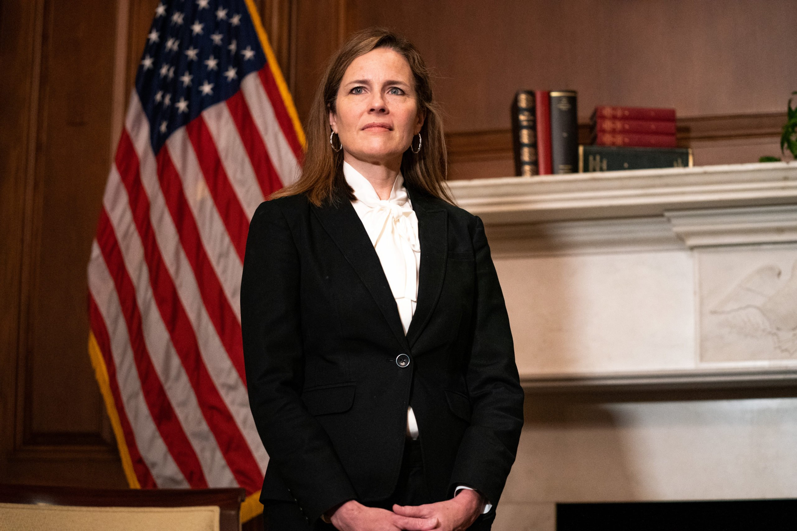 WASHINGTON, DC - OCTOBER 1: Judge Amy Coney Barrett, President Donald Trump's nominee for Supreme Court, poses for a photo before a meeting with Senator Steve Daines, R-Mont., at the United States Capitol Building on October 1, 2020 in Washington, DC. (Photo by Anna Moneymaker - Pool/Getty Images)