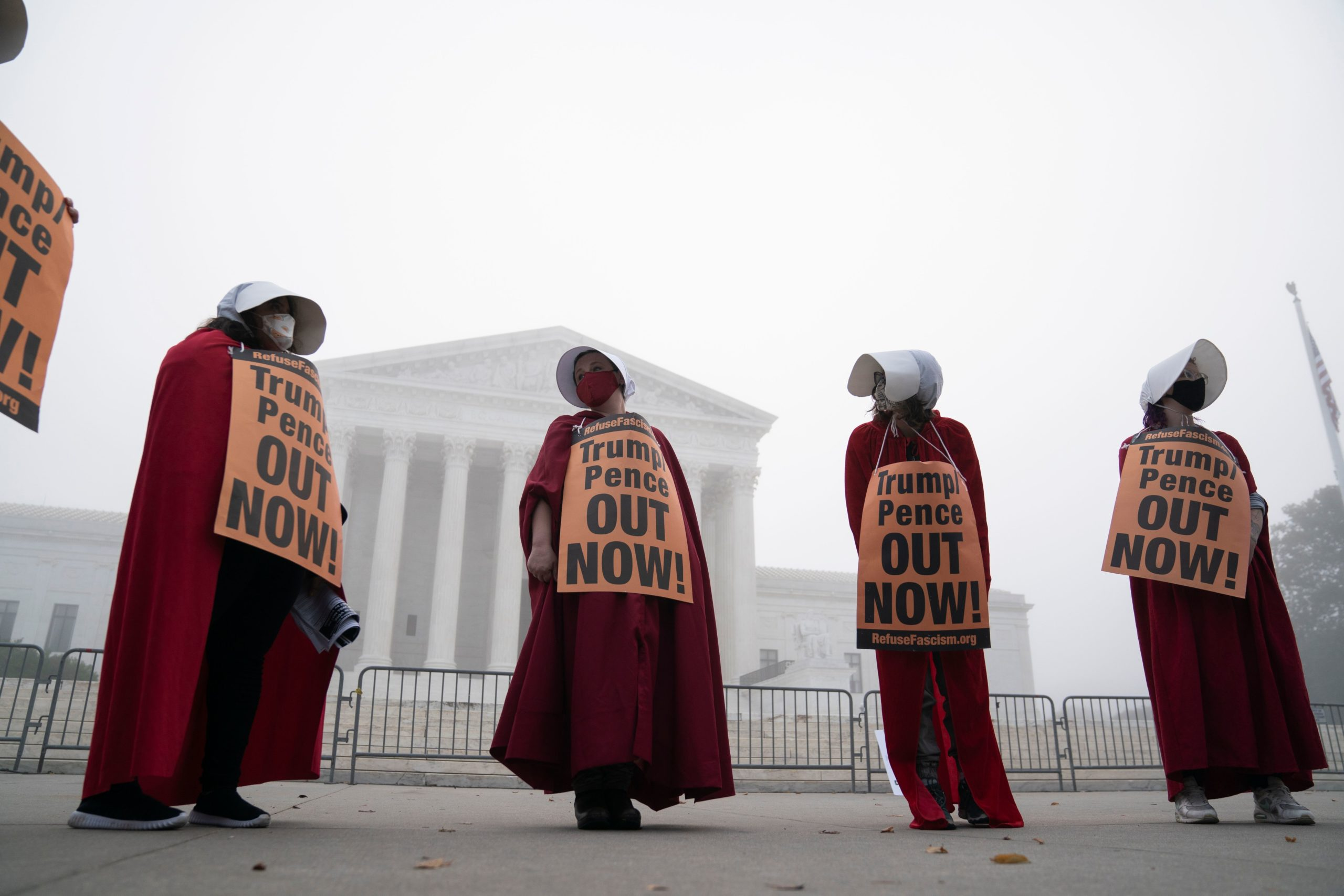 Demonstrators dressed as Handmaid's Tale protest the nomination of Amy Coney Barrett to be a US Supreme Court Justice at the US Supreme Court in Washington, DC, on October 22, 2020. - The Senate Judiciary Committee approved Barrett's nomination despite a boycott of the proceedings by Democratic committee members. (Photo by Alex Edelman / AFP) (Photo by ALEX EDELMAN/AFP via Getty Images)
