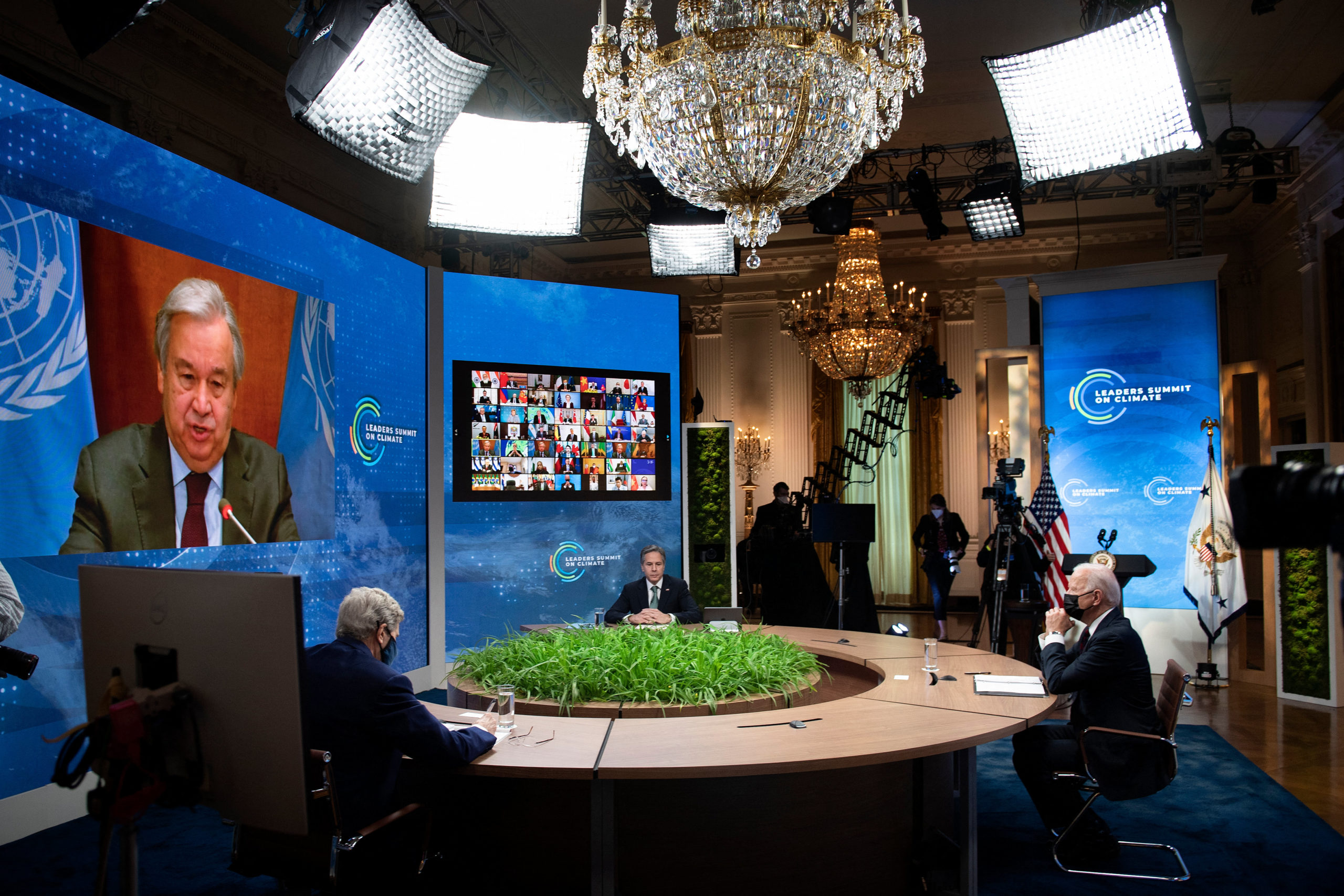 John Kerry, Secretary of State Antony Blinken, and President Joe Biden participate in a climate change virtual summit from the White House in April. (BRENDAN SMIALOWSKI/AFP via Getty Images)