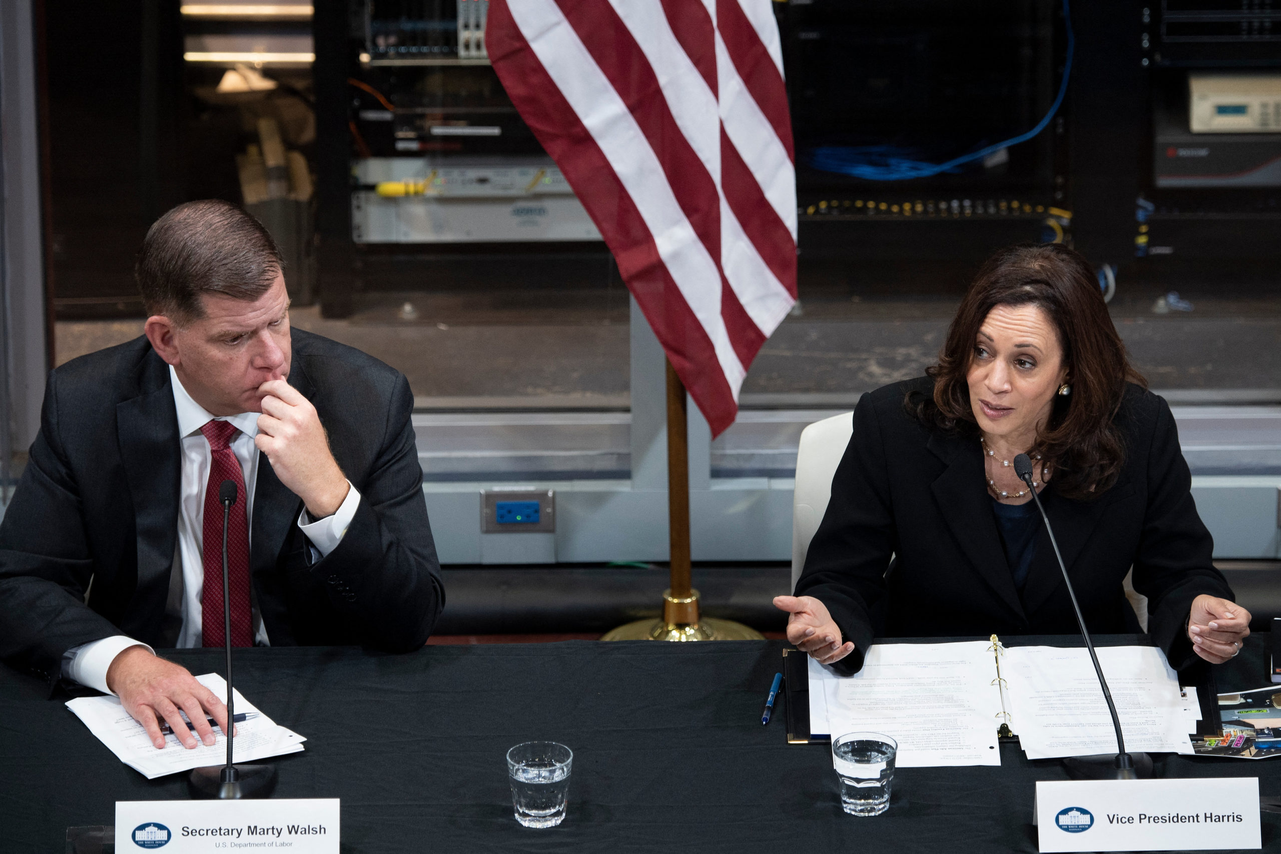 Secretary of Labor Marty Walsh listens while Vice President Kamala Harris speaks at a round table discussion on June 21 in Pittsburgh, Pennsylvania. (Brendan Smialowski/AFP via Getty Images)