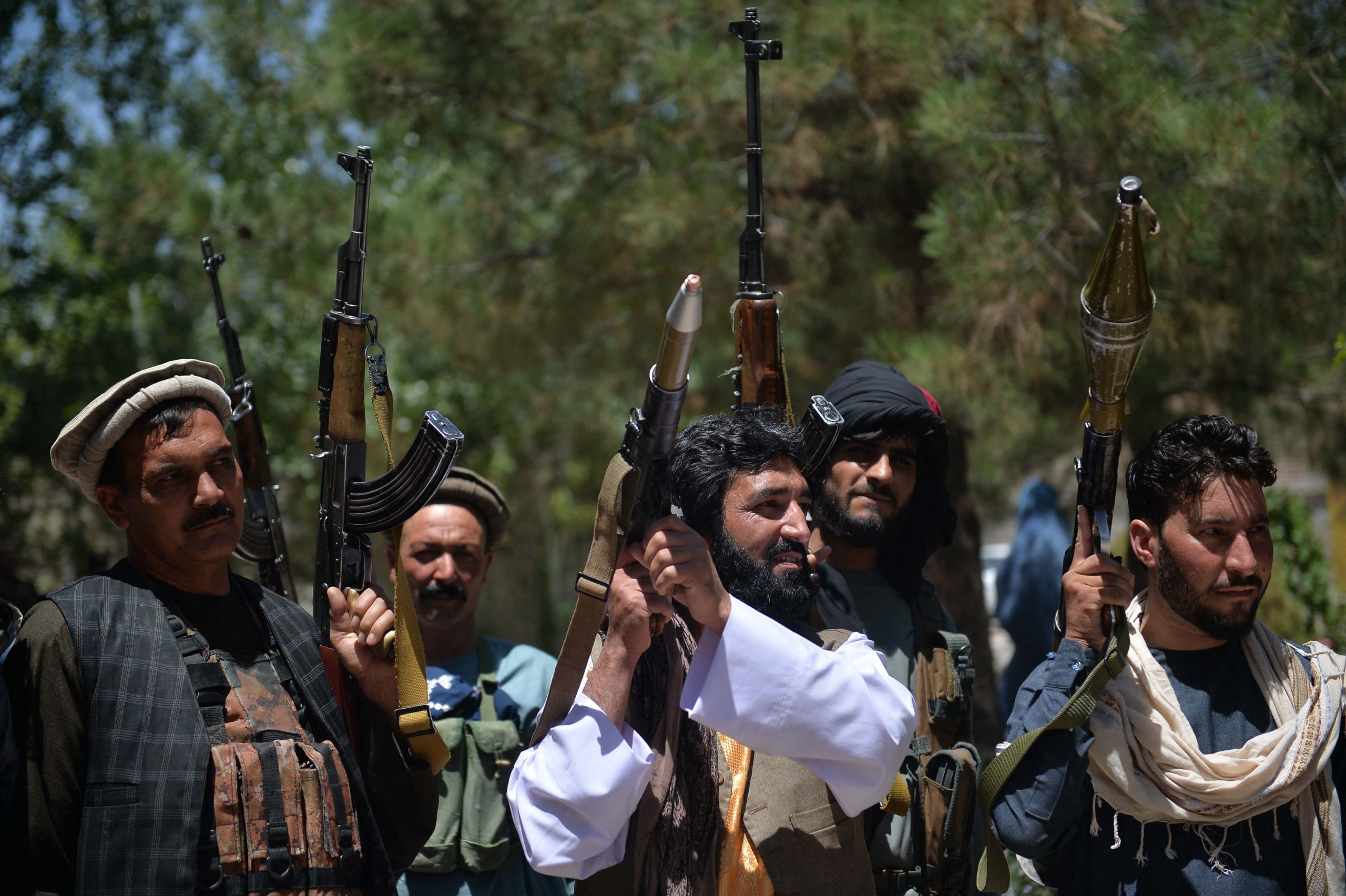 People gather with their heavy weapons to support Afghanistan security forces against the Taliban, in Guzara district, Herat province on June 23, 2021. (HOSHANG HASHIMI/AFP via Getty Images)