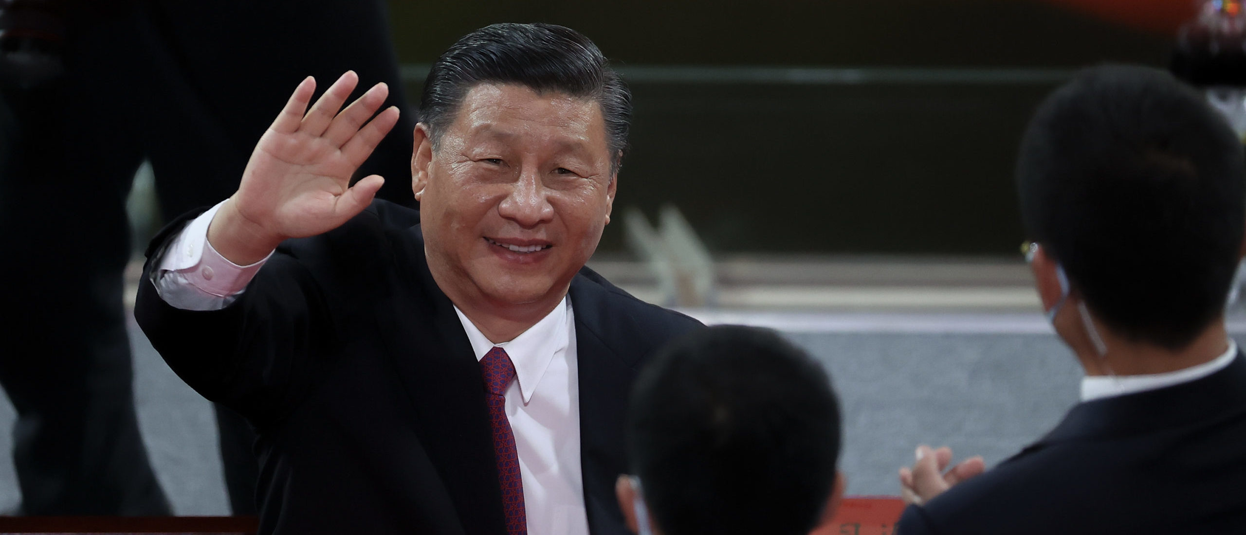 Chinese President Xi Jinping waves as he attends the art performance celebrating the 100th anniversary of the Founding of the Communist Party of China on June 28, 2021 in Beijing, China. (Photo by Lintao Zhang/Getty Images)