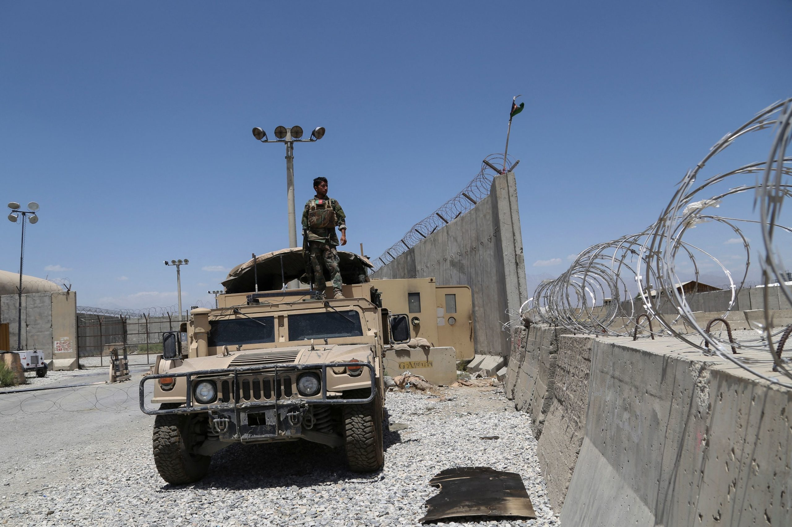 An Afghan National Army soldier looks out while standing on a Humvee vehicle at Bagram Air Base after all U.S. troops left on July 2. (Zakeria Hashimi/AFP via Getty Images)