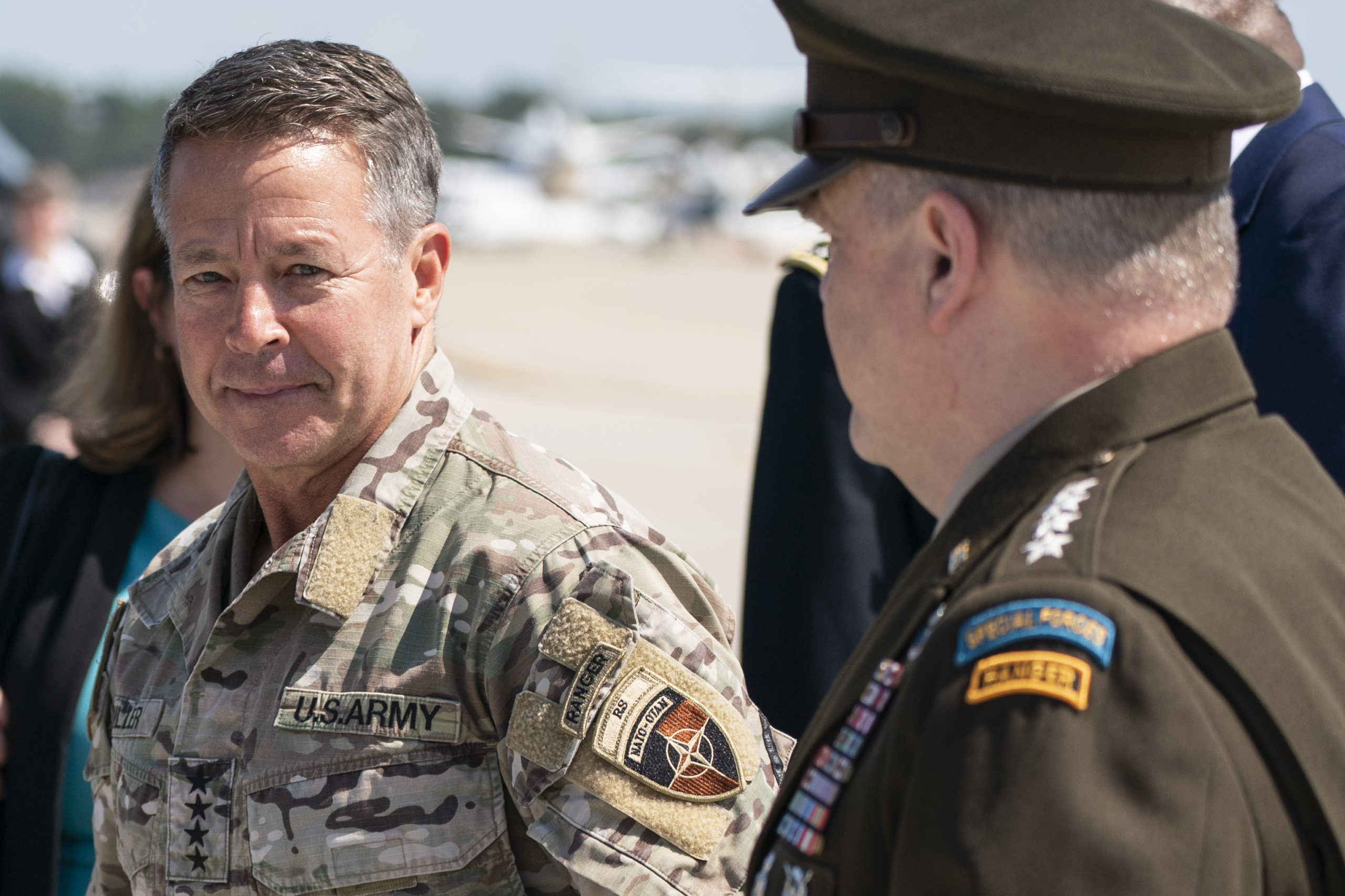 JOINT BASE ANDREWS, MD - JUNE 14: U.S. Army Gen. Scott Miller, the former top U.S. commander in Afghanistan(L), walks with Joint Chiefs Chairman Gen. Mark Milley, upon Millers return on July 14, 2021 at Andrews Air Force Base, Maryland. Gen. Mark Milley stepped down on July 12, 2021 and transferred command duties to Gen. Kenneth McKenzie as the US military withdrawal from Afghanistan continues. (Photo by Alex Brandon - Pool/Getty Images)