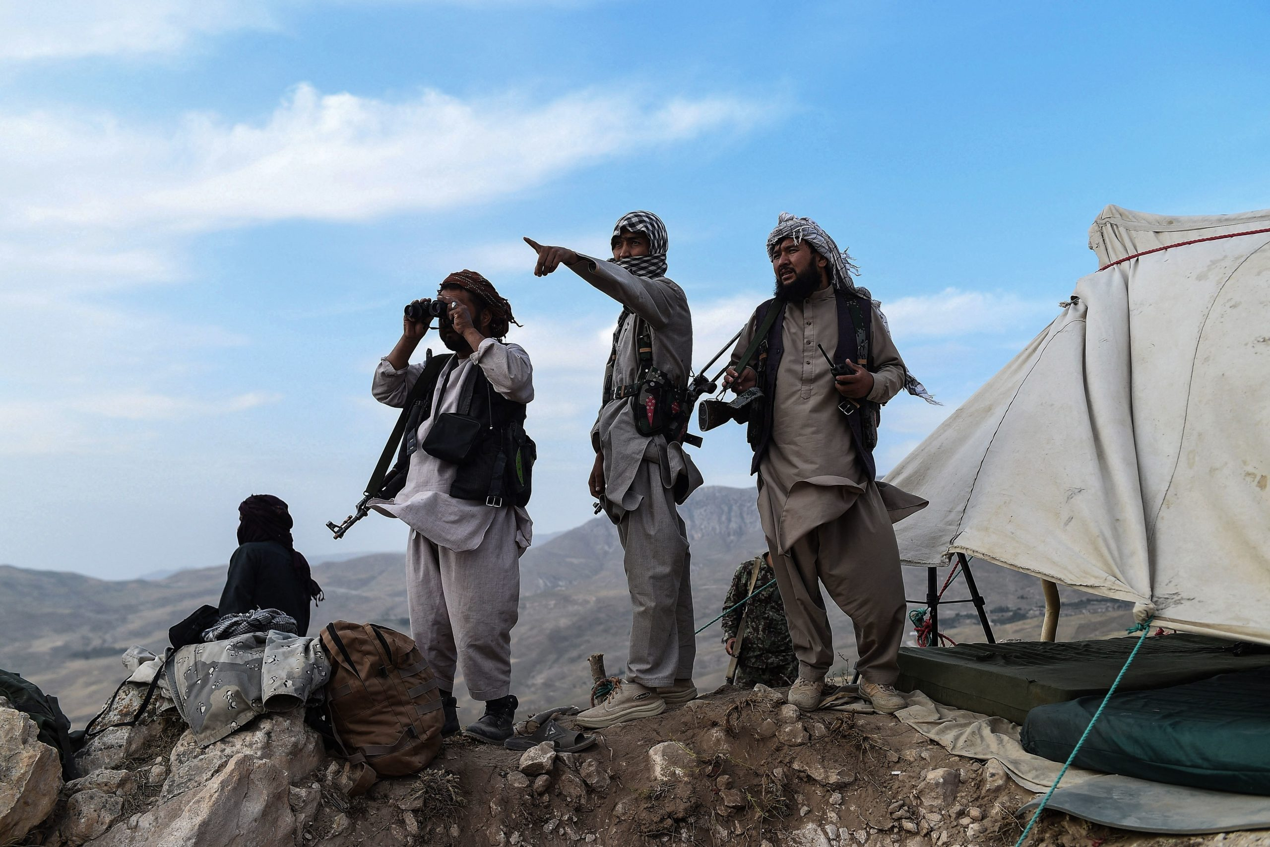 In this picture taken on July 15, 2021, Afghan militia fighters keep a watch at an outpost against Taliban insurgents at Charkint district in Balkh Province. (Photo by FARSHAD USYAN / AFP) (Photo by FARSHAD USYAN/AFP via Getty Images)