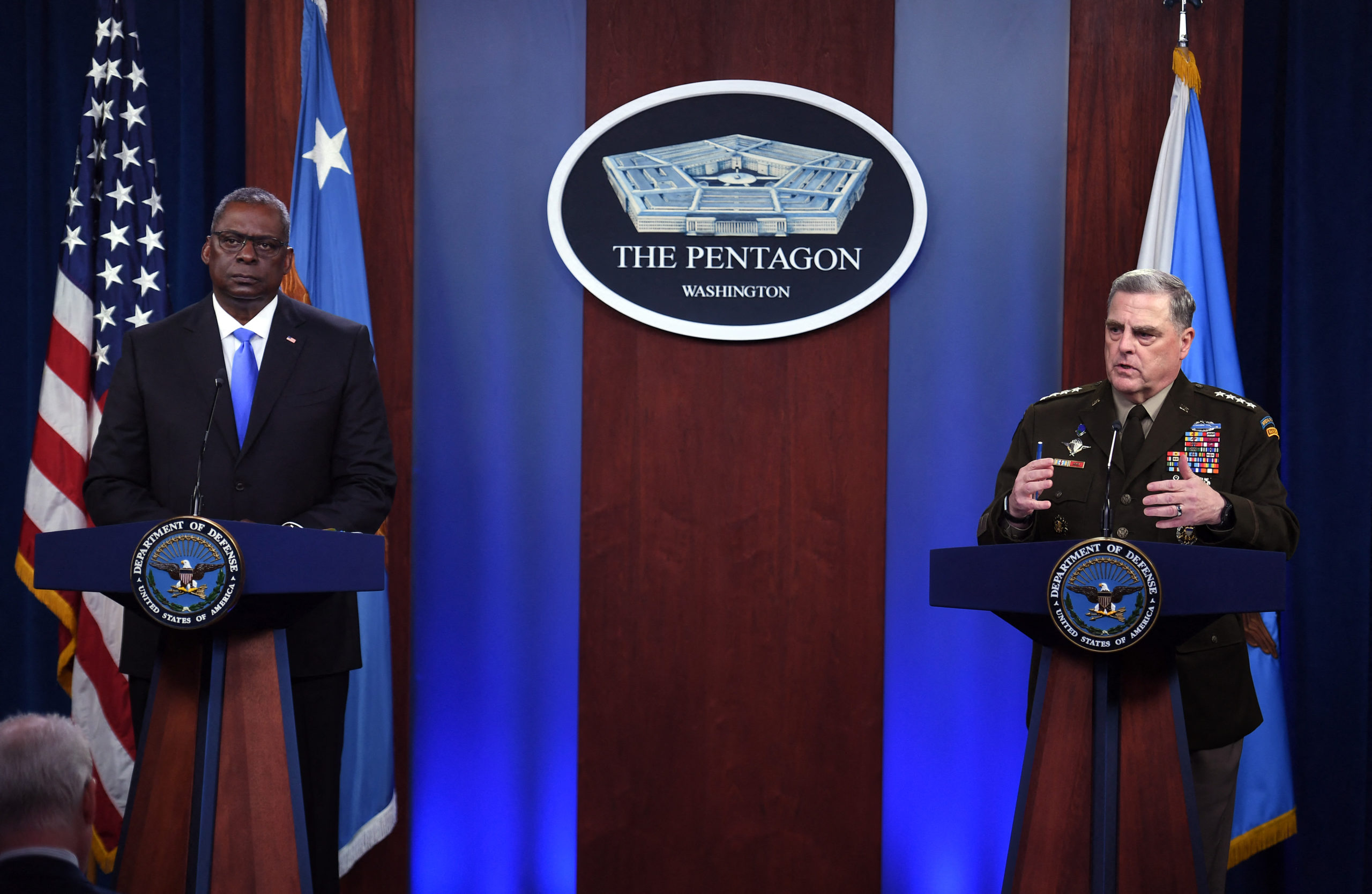 US Defense Secretary Lloyd Austin (L) and Chairman of the Joint Chiefs of Staff, General Mark Milley, hold a press conference on July 21, 2021, at The Pentagon in Washington, DC. (Photo by Olivier DOULIERY / AFP) (Photo by OLIVIER DOULIERY/AFP via Getty Images)