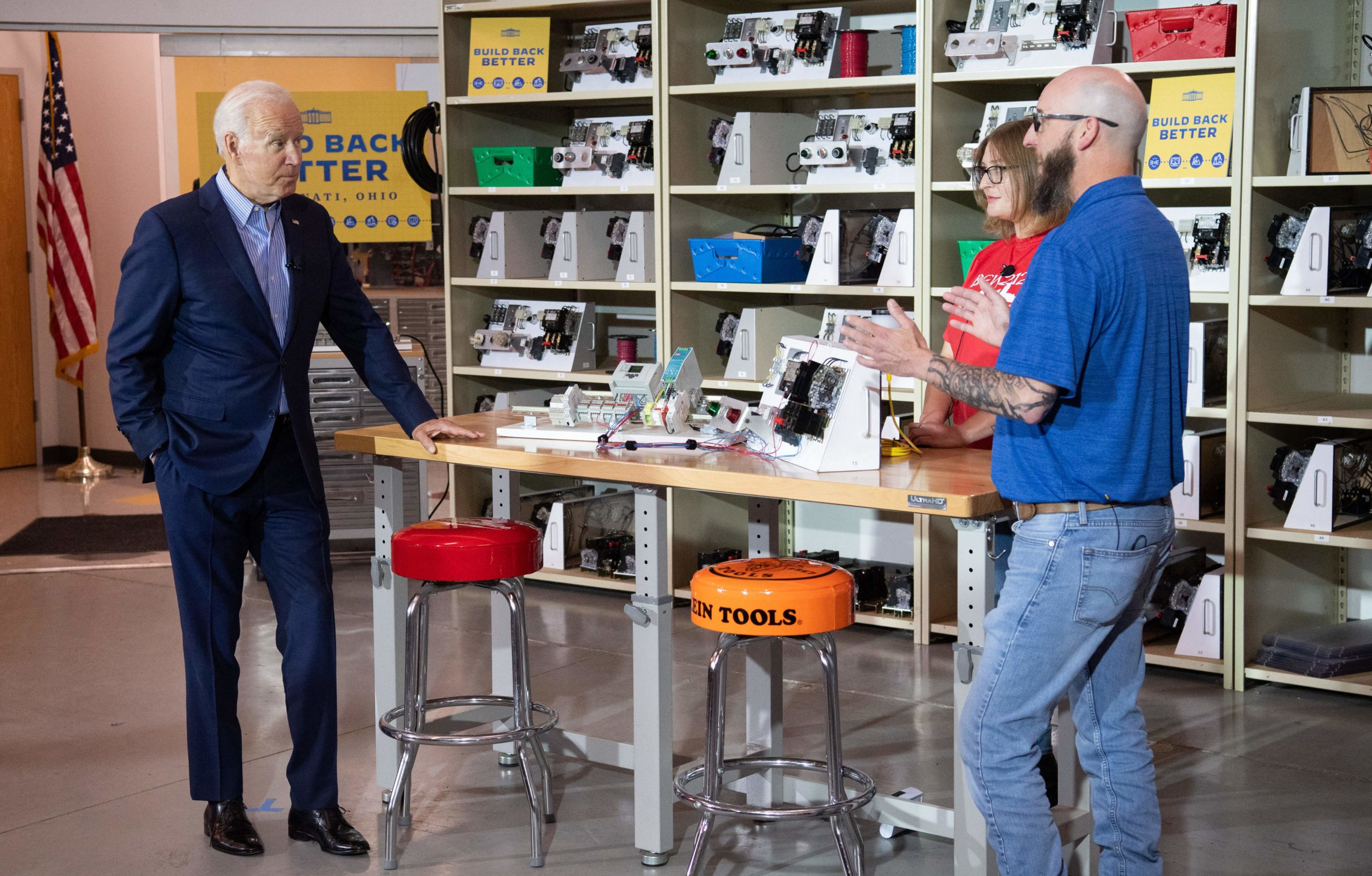 President Joe Biden speaks with an instructor and an apprentice at a union training center in Cincinnati, Ohio, on Wednesday. (Saul Loeb/AFP via Getty Images)
