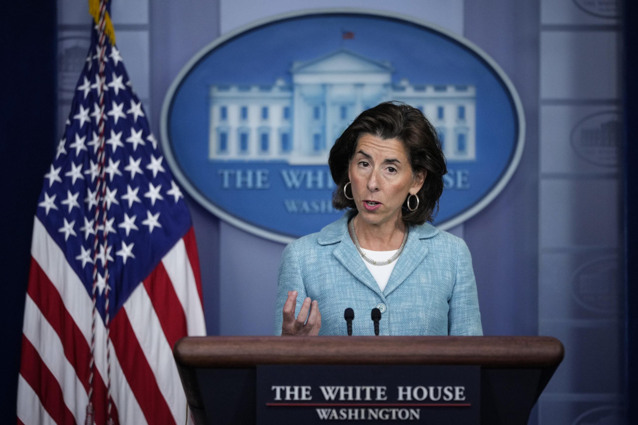 Commerce Secretary Gina Raimondo addresses reporters on Thursday. (Drew Angerer/Getty Images)