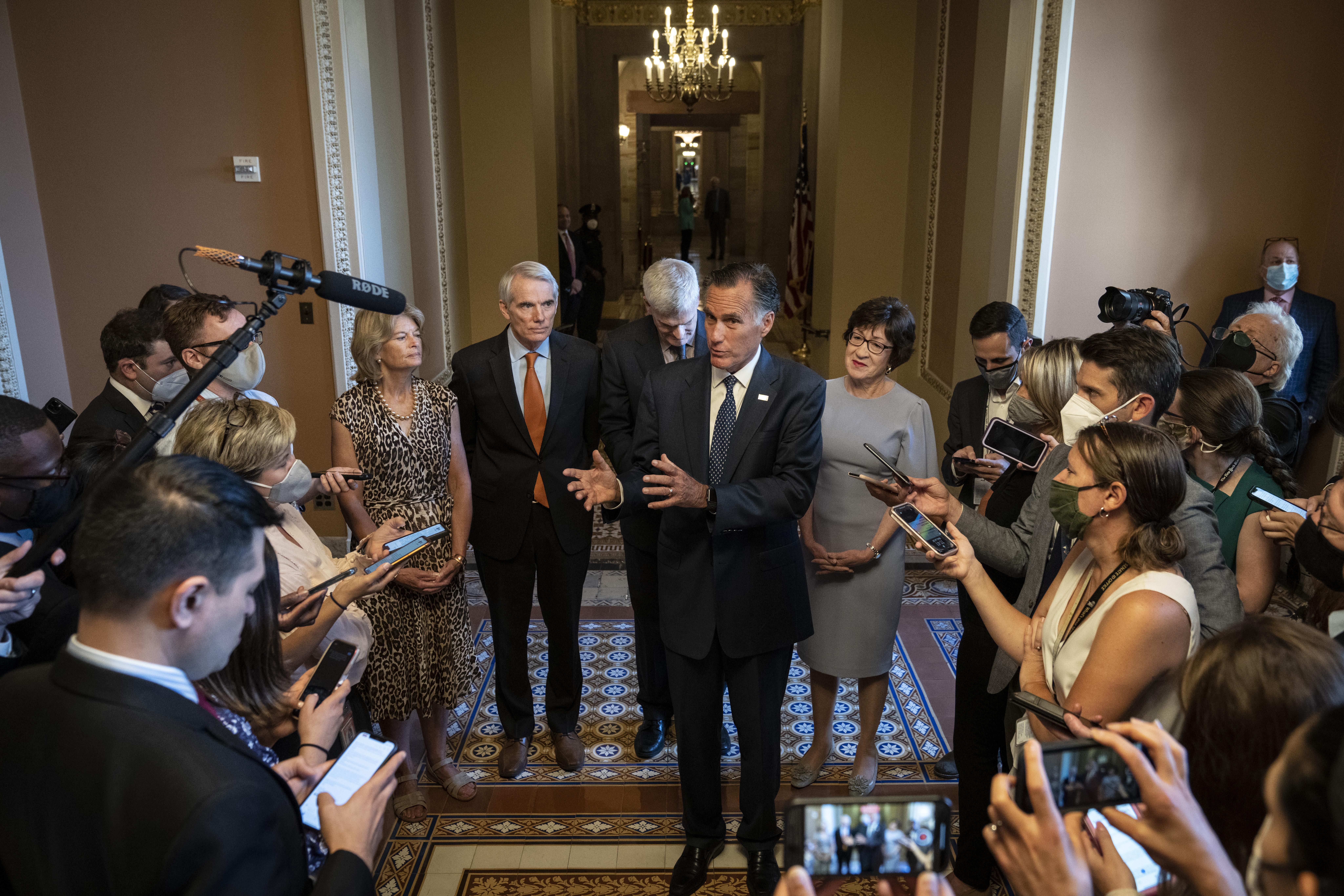 The lead GOP negotiators – Sens. Lisa Murkowski, Rob Portman, Bill Cassidy, Mitt Romney and Susan Collins speak at the Capitol on Wednesday. (Drew Angerer/Getty Images)
