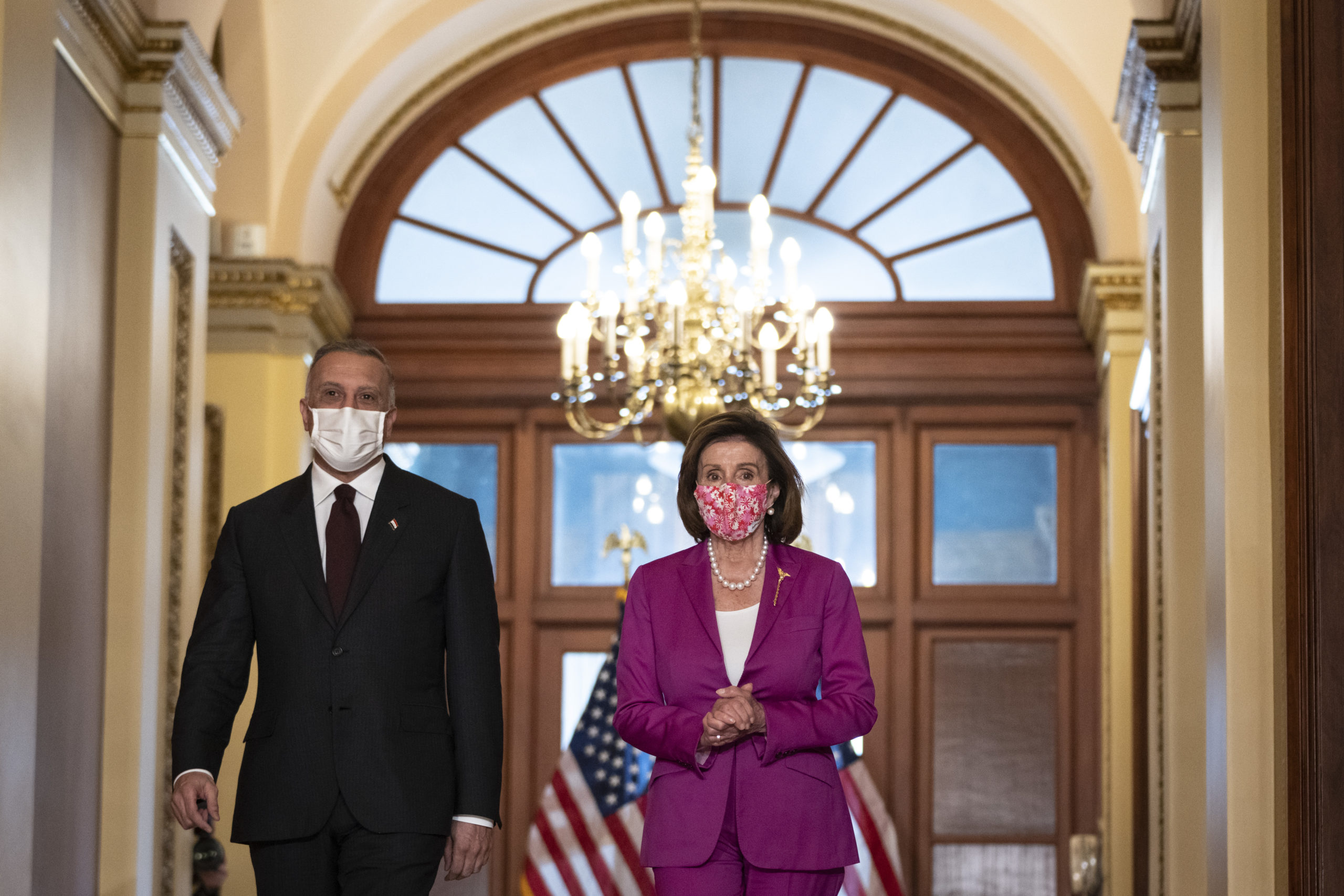 (L-R) Iraqi Prime Minister Mustafa al-Kadhimi and Speaker of the House Nancy Pelosi (D-CA) arrive to speak briefly to the press outside of her office at the U.S. Capitol on July 28, 2021 in Washington, DC. (Photo by Drew Angerer/Getty Images)