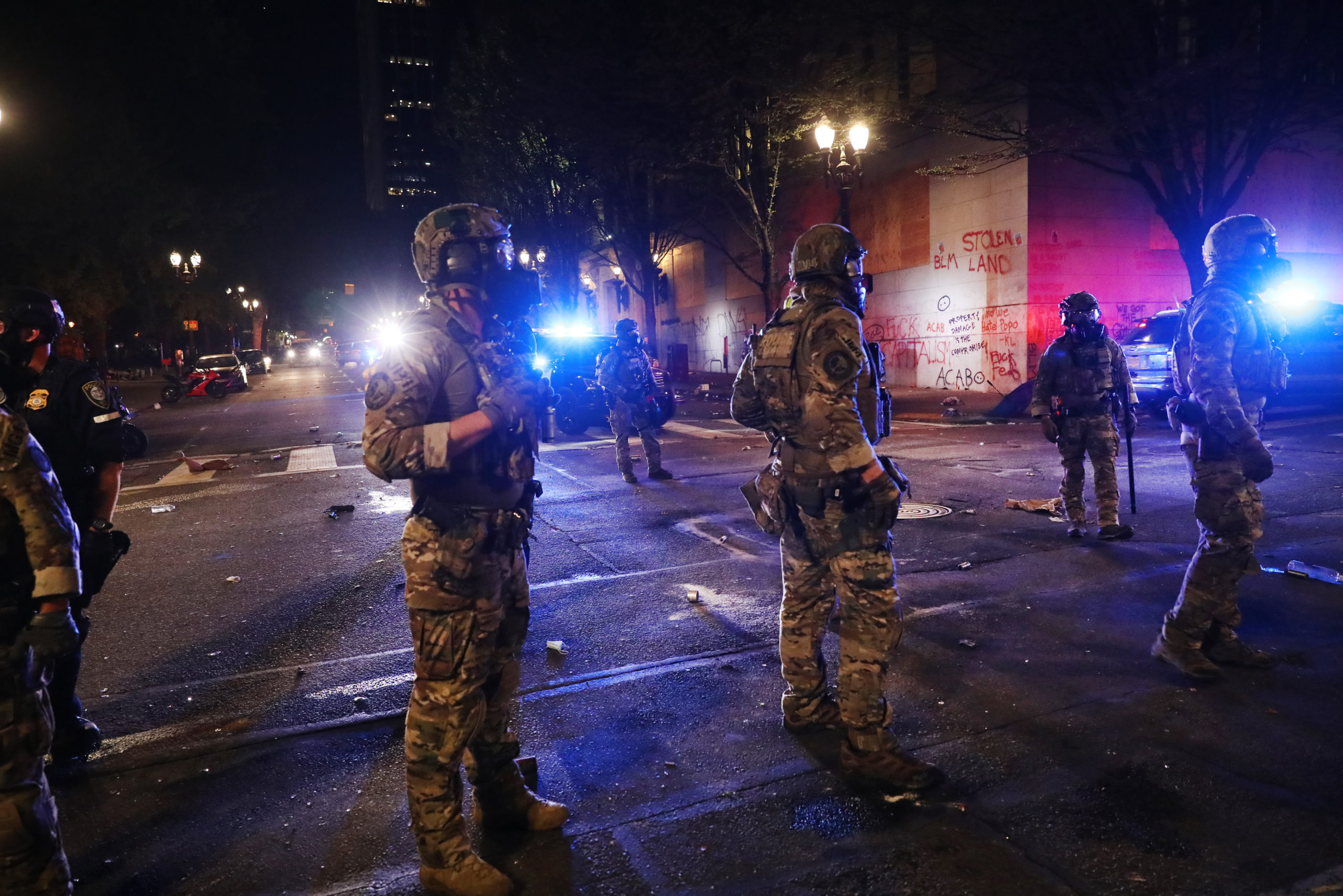 Federal Police clash with protesters in front of the Mark O. Hatfield federal courthouse in downtown Portland as the city experiences another night of unrest on July 25, 2020 in Portland, Oregon. (Photo by Spencer Platt/Getty Images)