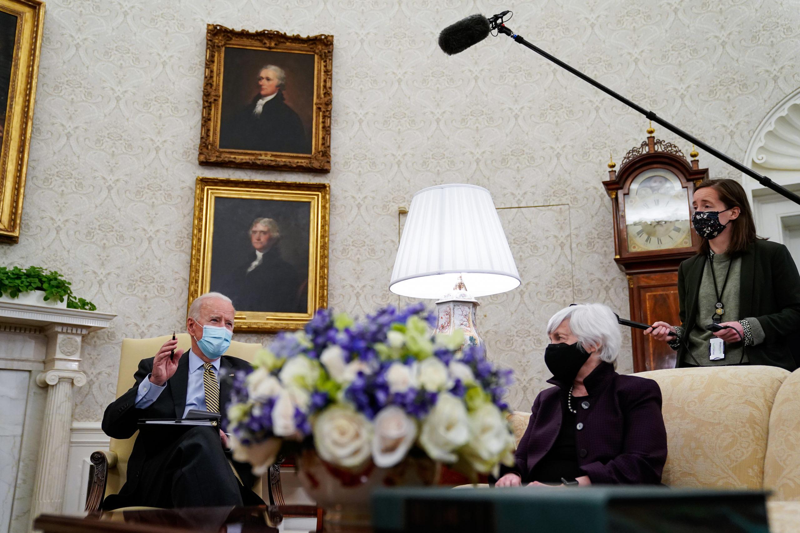 President Joe Biden speaks as Treasury Secretary Janet Yellen listens during a White House meeting on April 9. (Amr Alfiky/Pool/Getty Images)