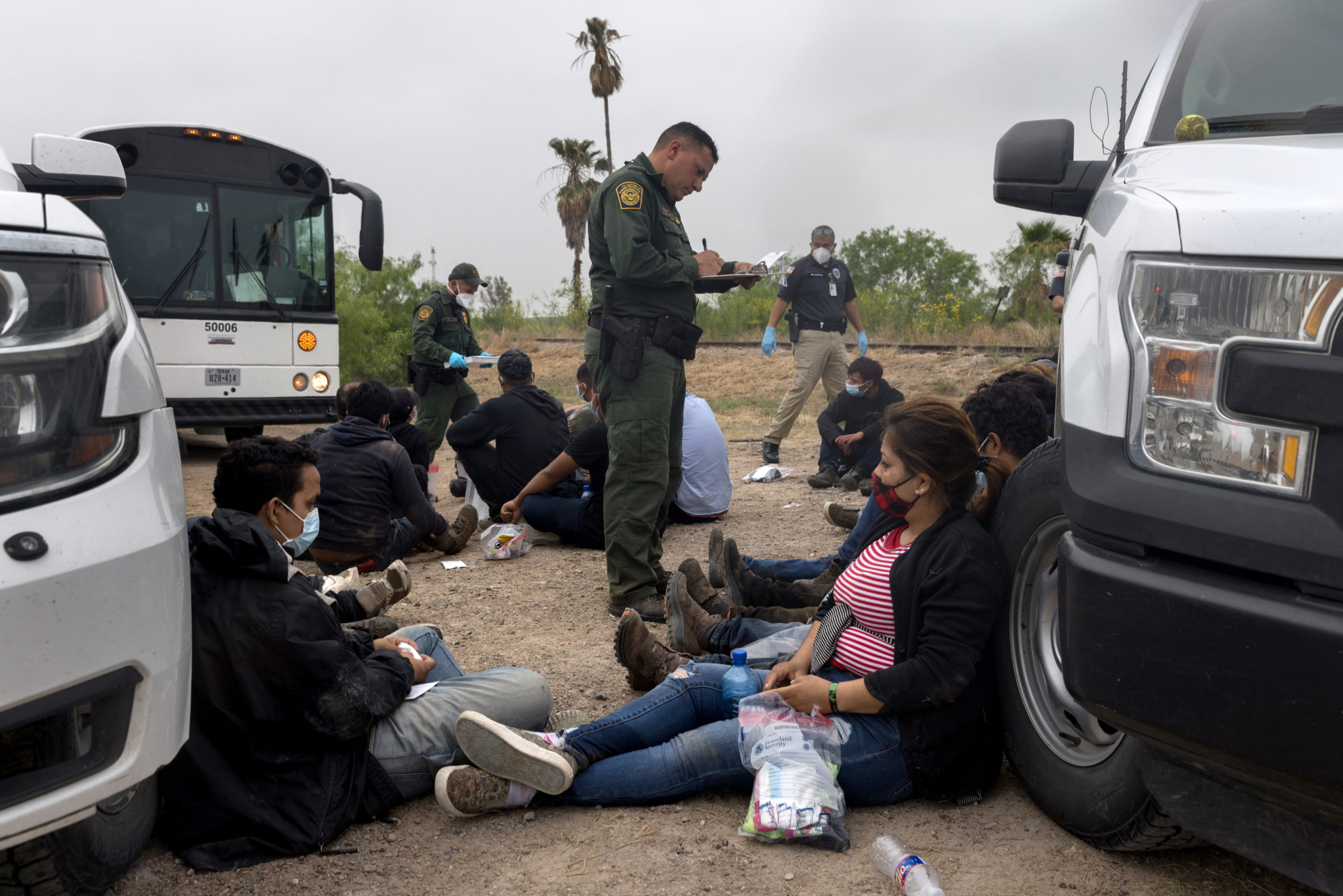 A U.S. Border Patrol agent registers immigrants before bussing them to a processing center near the U.S.-Mexico border on April 13, 2021 in La Joya, Texas. (Photo by John Moore/Getty Images)