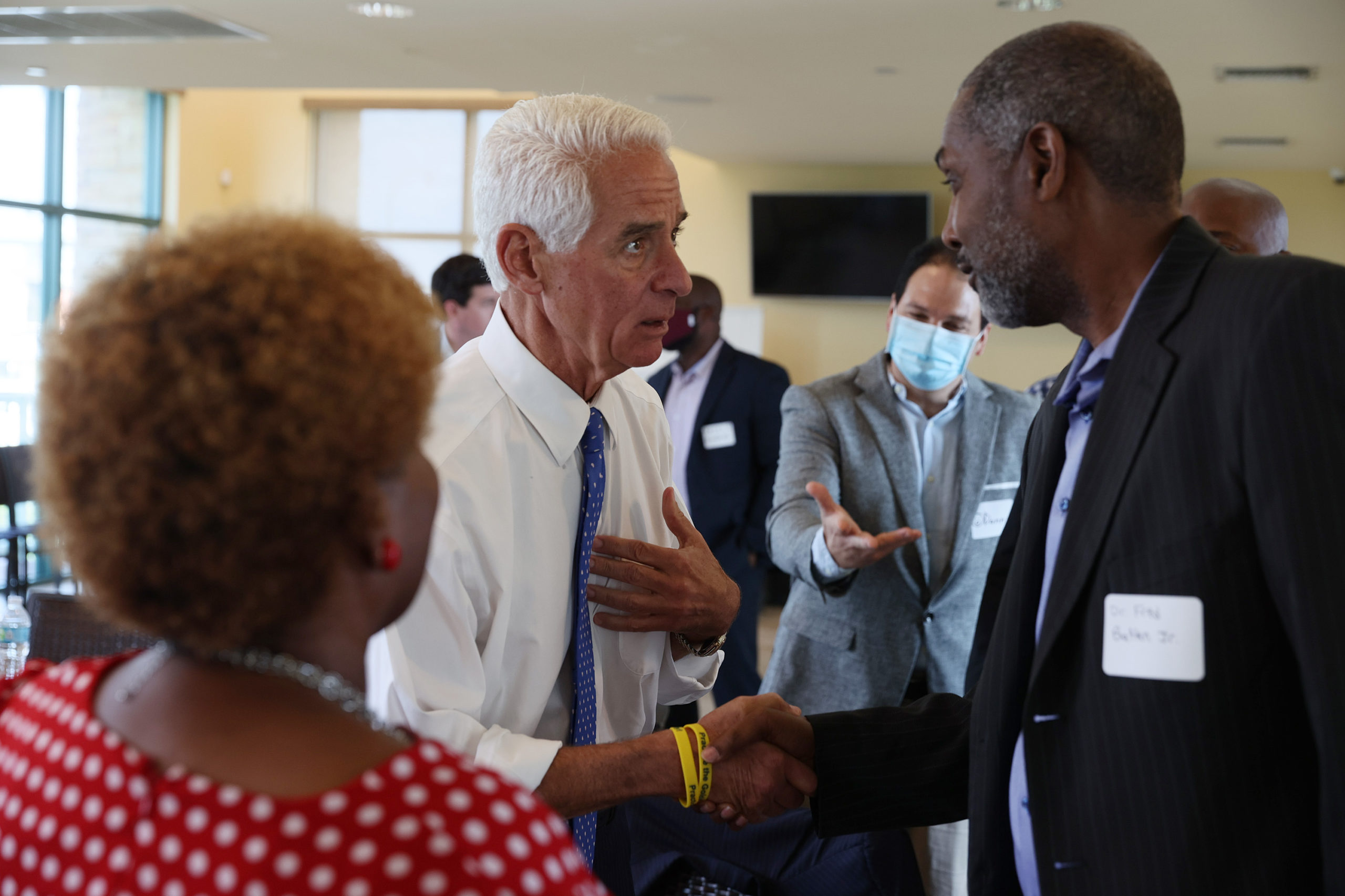 Rep. Charlie Crist (D-FL), candidate for Governor of Florida, greets Dr. Fred Batten Jr. during a Voting Rights Tour event held at the Lallos Restaurant on June 10, 2021 in Lauderhill, Florida. (Photo by Joe Raedle/Getty Images)