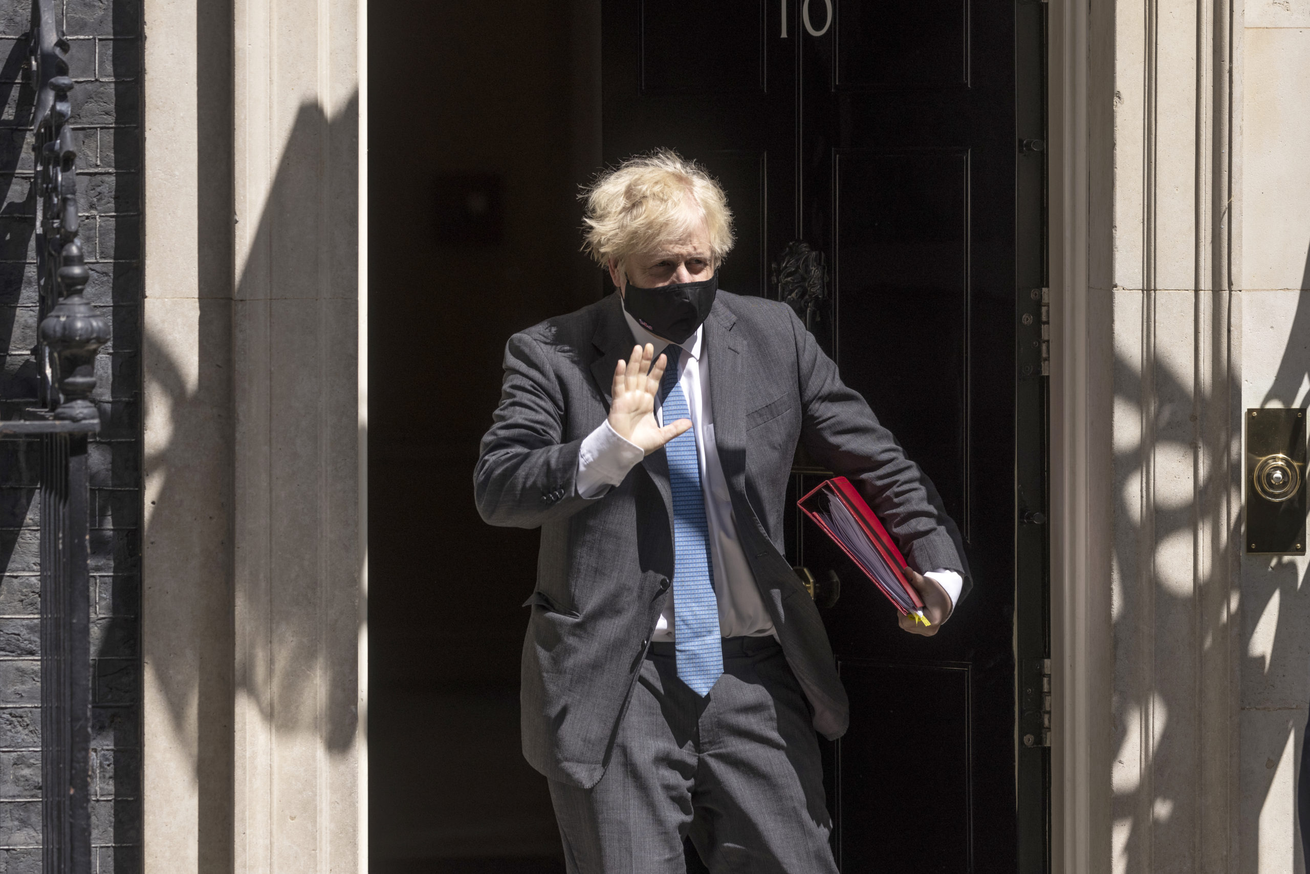 British Prime Minister Boris Johnson leaves 10 Downing Street wearing a face mask on June 23 in London, England. (Dan Kitwood/Getty Images)