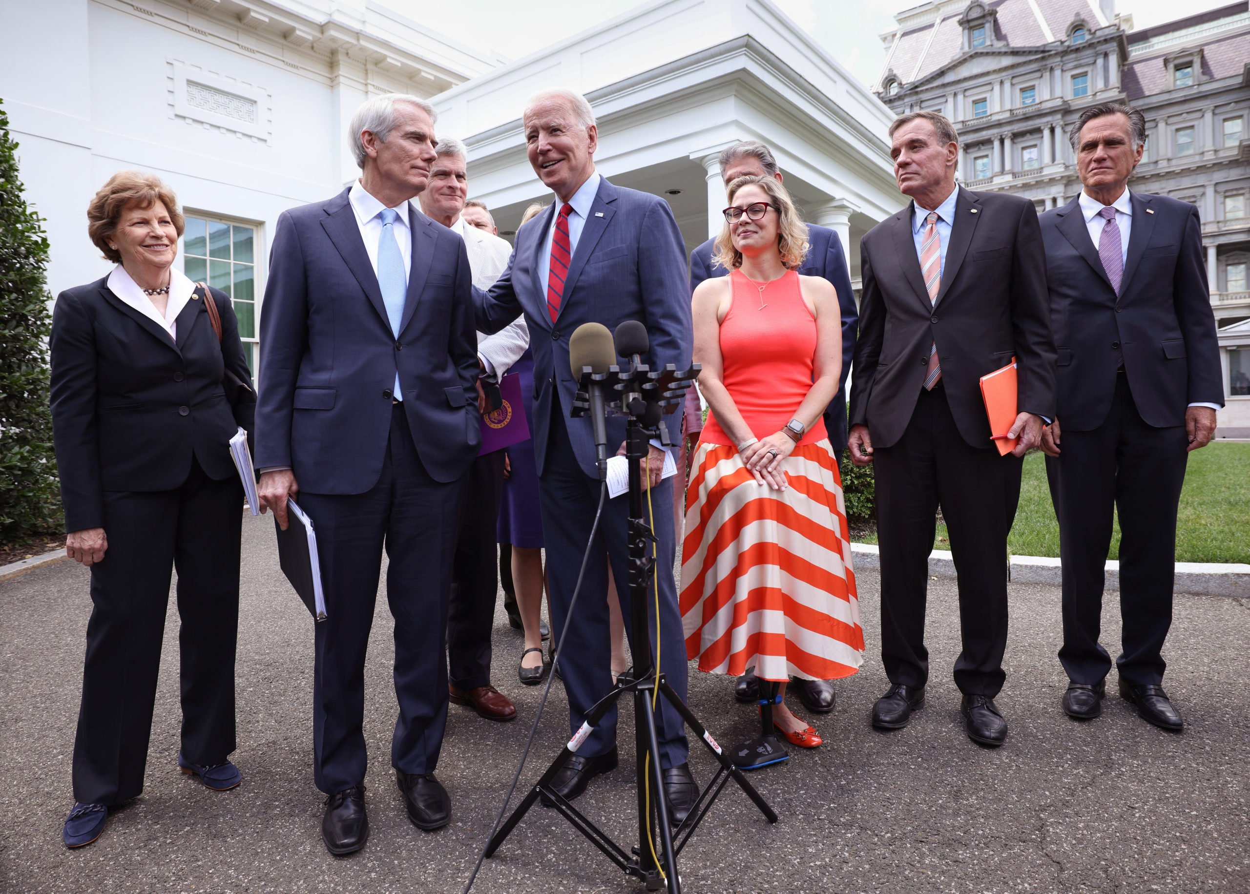 President Joe Biden speaks with a bipartisan group of Senators after reaching a deal on an infrastructure package on June 24. (Kevin Dietsch/Getty Images)