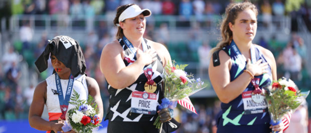 EUGENE, OREGON - JUNE 26: Gwendolyn Berry (L), third place, looks on during the playing of the national anthem with DeAnna Price (C), first place, and Brooke Andersen, second place, on the podium after the Women's Hammer Throw final on day nine of the 2020 U.S. Olympic Track & Field Team Trials at Hayward Field on June 26, 2021 in Eugene, Oregon. (Photo by Patrick Smith/Getty Images)