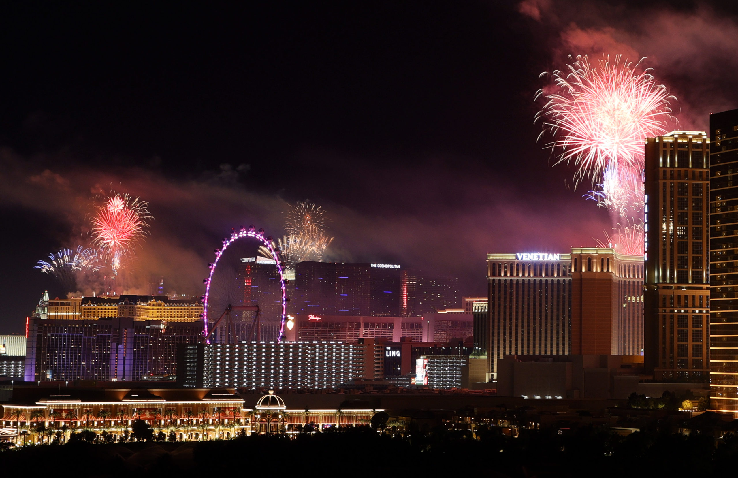 """Fireworks by Grucci light up the sky above resorts on the Las Vegas Strip in a Fourth of July celebration on July 4, 2021 in Las Vegas, Nevada. The Las Vegas Convention and Visitors Authority presented a themed, coordinated fireworks show from eight hotel-casinos on Independence Day for the first time to show that the """"Entertainment Capital of the World"""" is fully reopened. Last month, Clark County dropped all COVID-19 pandemic mandates, which removed all capacity and social distancing restrictions. (Photo by Ethan Miller/Getty Images)"""