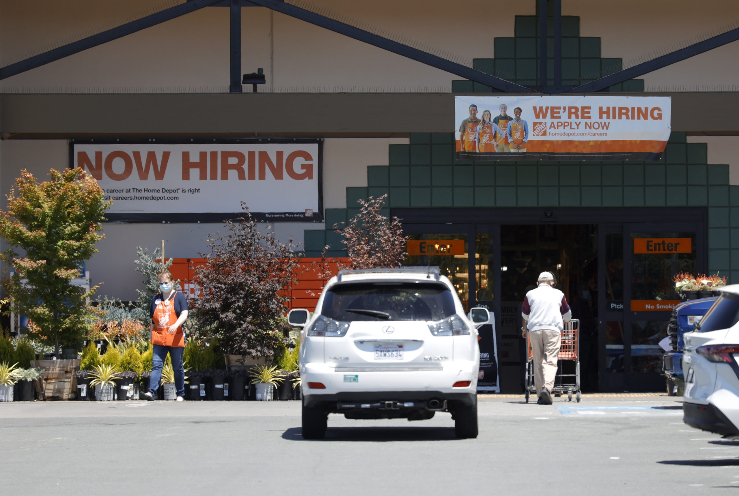 """""""Now Hiring"""" signs are posted in front of a Home Depot store on July 7 in San Rafael, California. (Justin Sullivan/Getty Images)"""