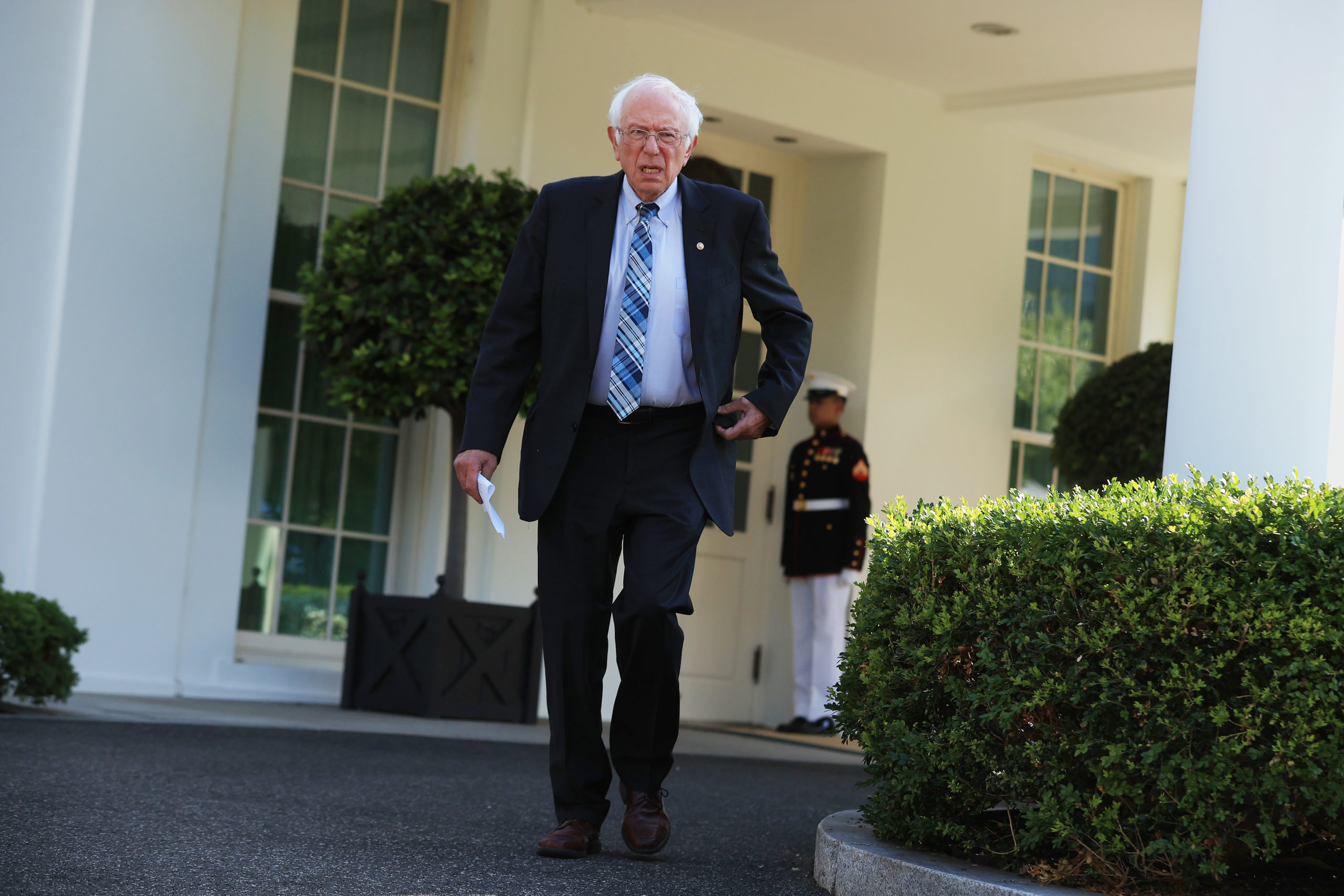 Sen. Bernie Sanders talks to reporters outside the West Wing after meeting with President Joe Biden on July 12. (Chip Somodevilla/Getty Images)
