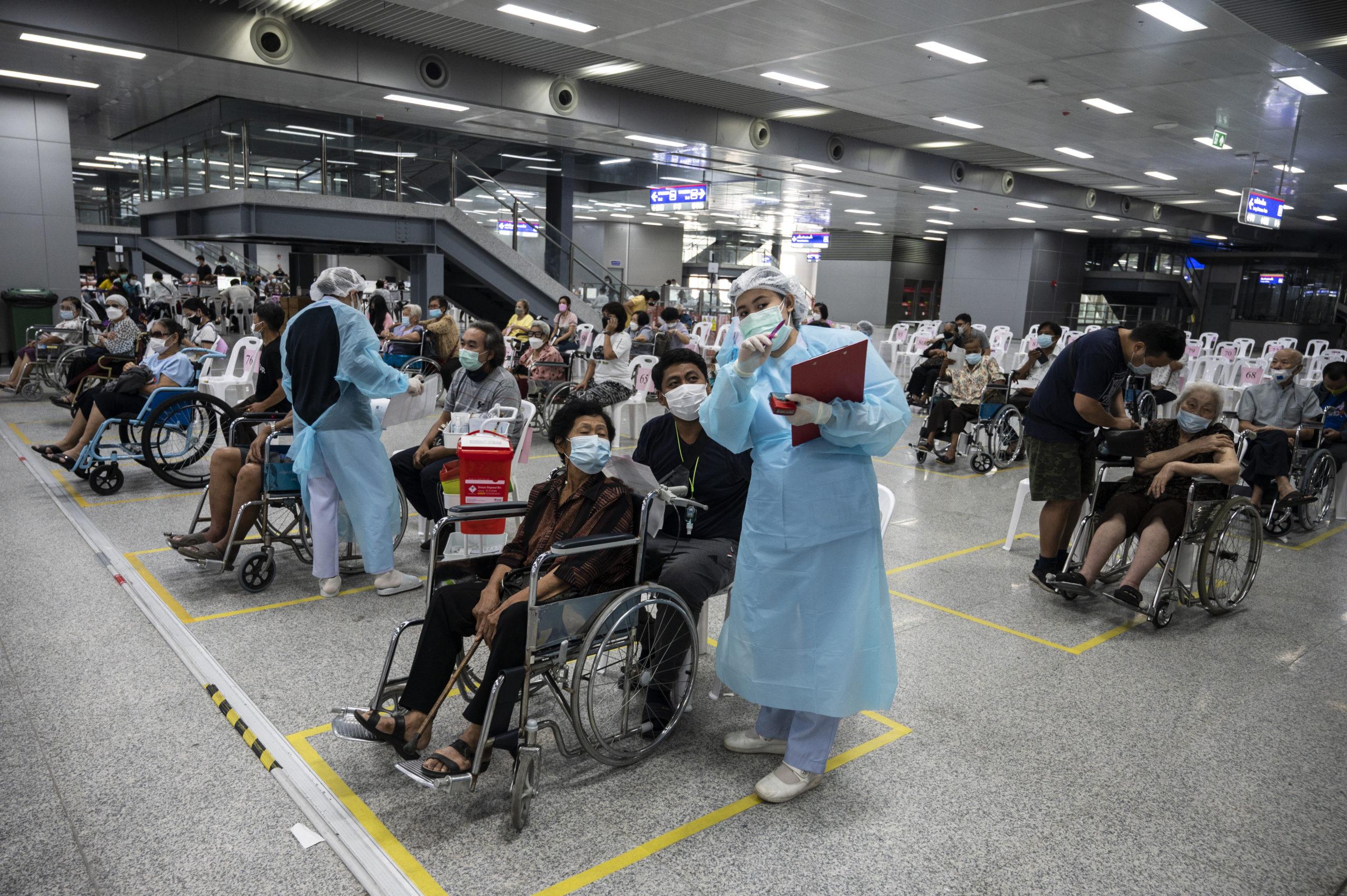 People wait in line to receive the AstraZeneca coronavirus vaccine in Bangkok, Thailand on July 13. (Sirachai Arunrugstichai/Getty Images)