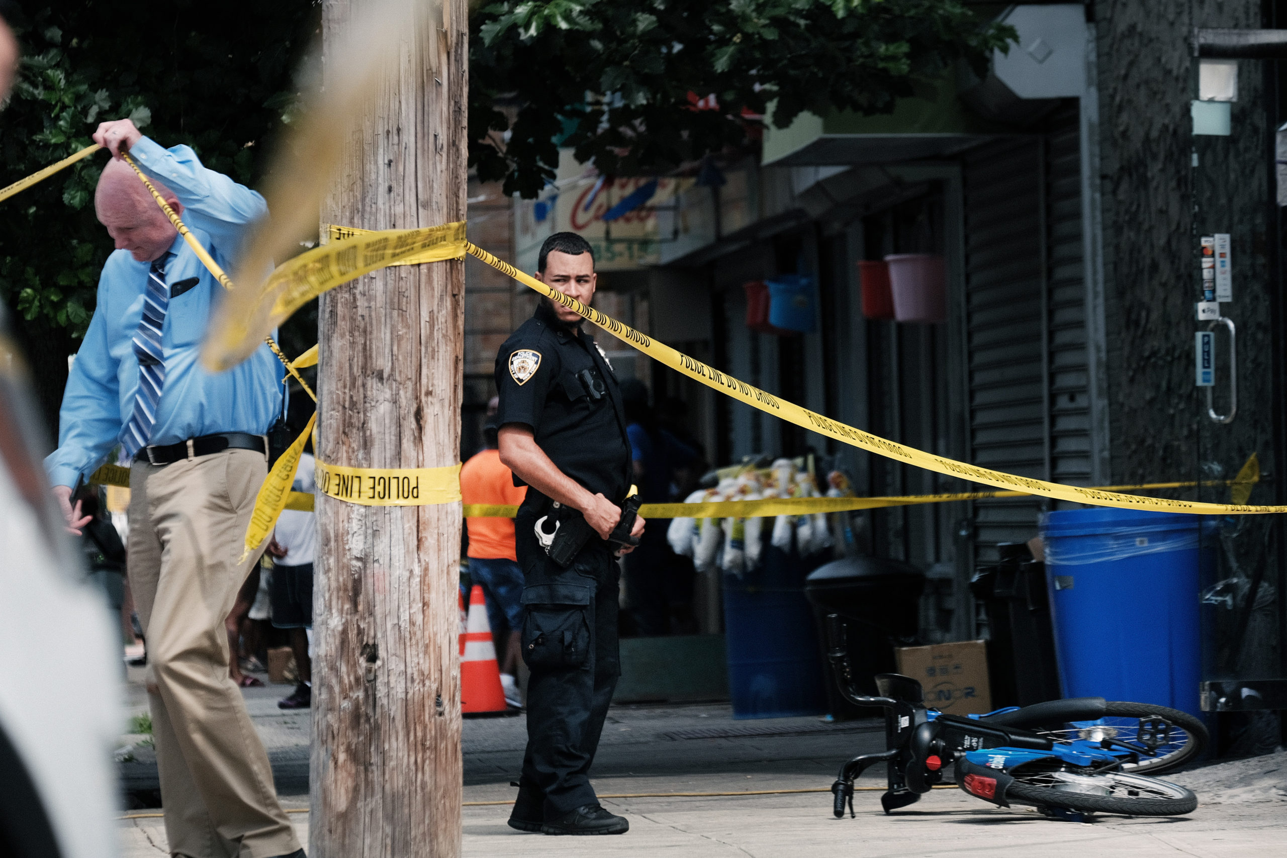 Police converge on the scene of a shooting in Brooklyn, one of numerous during the day, on July 14, 2021 in New York City. (Photo by Spencer Platt/Getty Images)