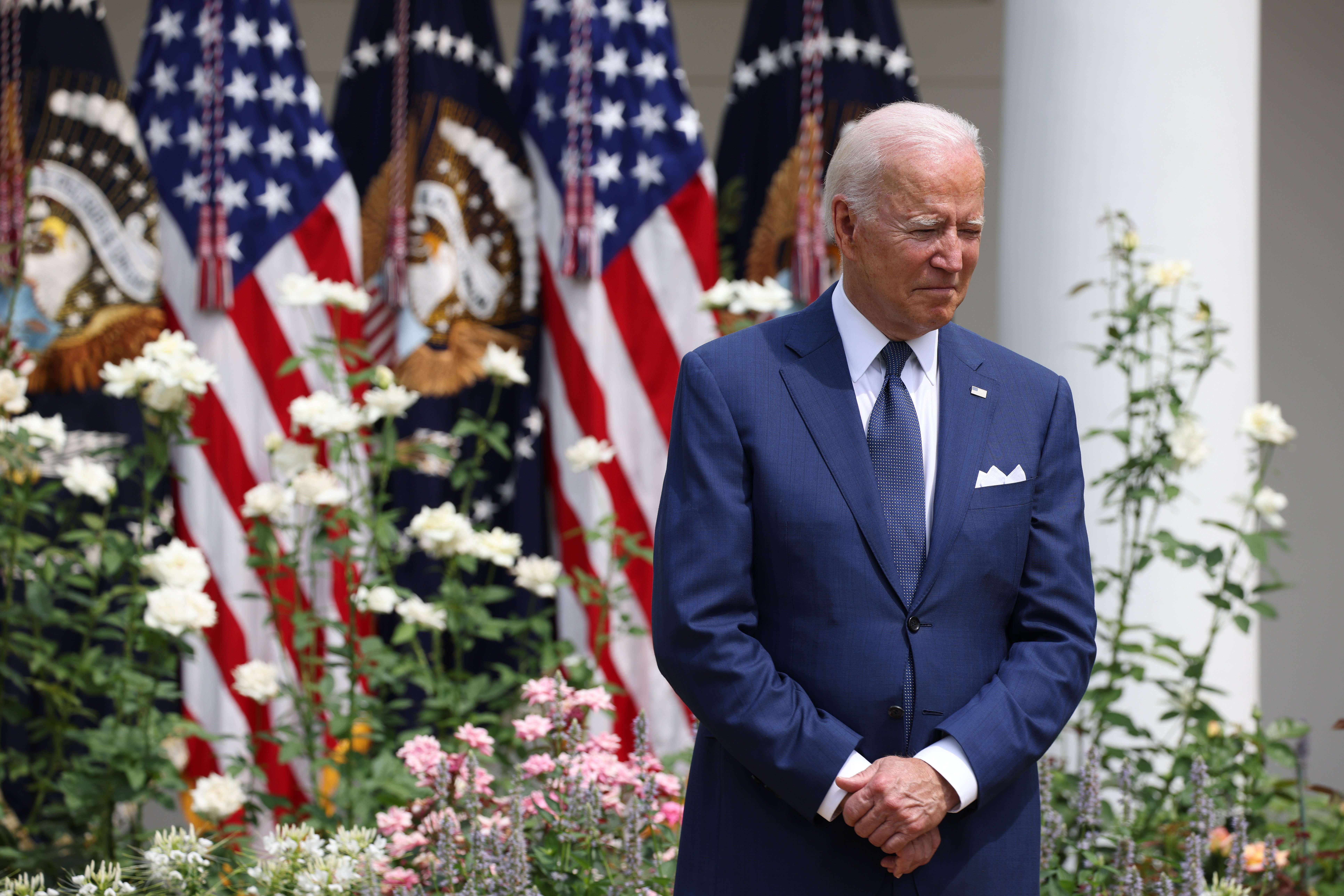 U.S. President Joe Biden listens as Vice President Kamala Harris delivers remarks in the Rose Garden of the White House on July 26, 2021 in Washington, DC. (Photo by Anna Moneymaker/Getty Images)