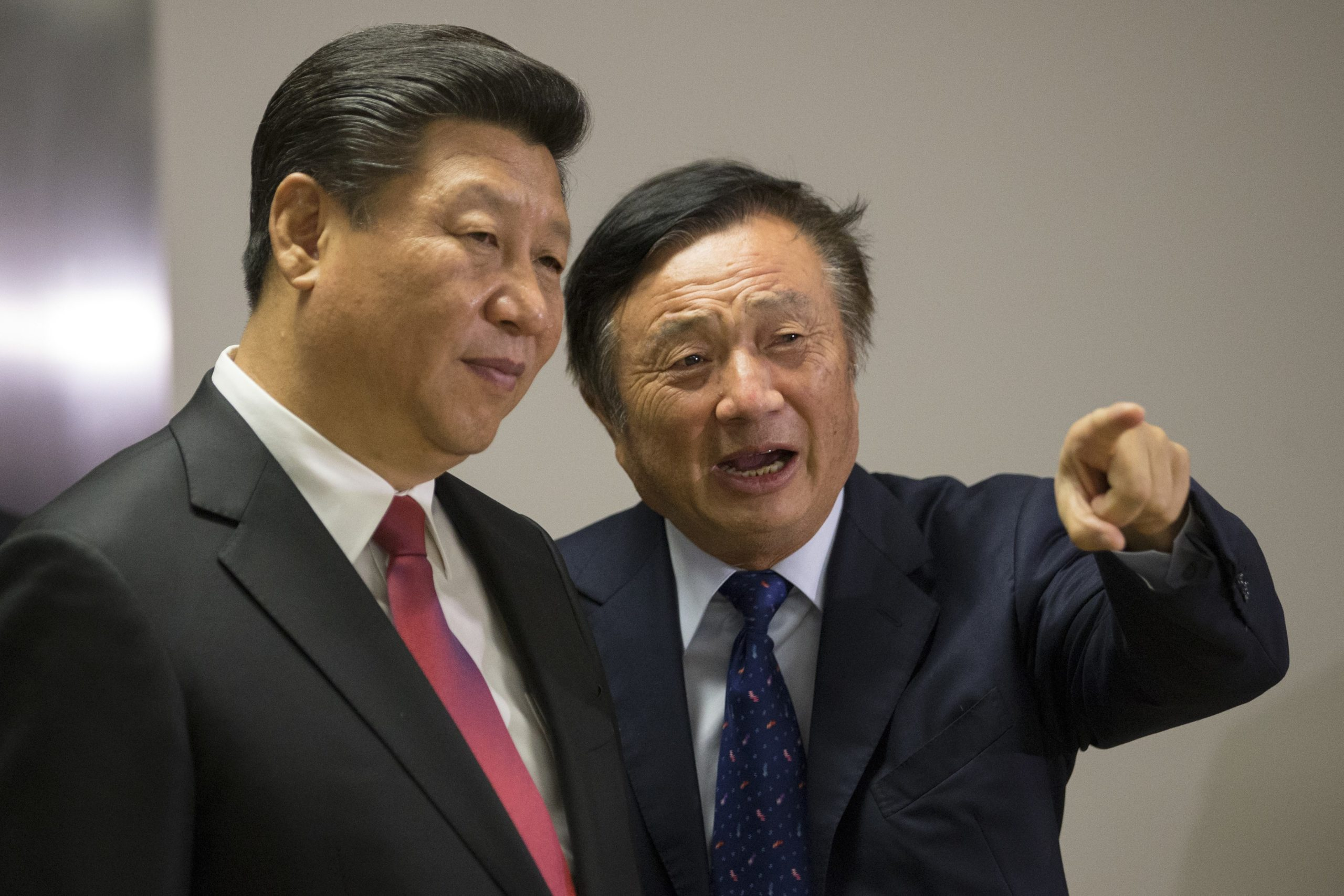 Chinese President Xi Jinping (L) is shown around the offices of Chinese tech firm Huawei technologies by its President Ren Zhengfei in London during his state visit on October 21, 2015. AFP PHOTO / POOL / Matthew Lloyd (Photo credit should read MATTHEW LLOYD/AFP via Getty Images)
