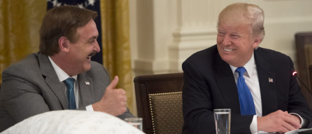 US President Donald Trump speaks alongside Mike Lindell (L), founder of My Pillow, during a Made in America event with US manufacturers in the East Room of the White House in Washington, DC, July 19, 2017. / AFP PHOTO / SAUL LOEB (Photo credit should read SAUL LOEB/AFP via Getty Images)