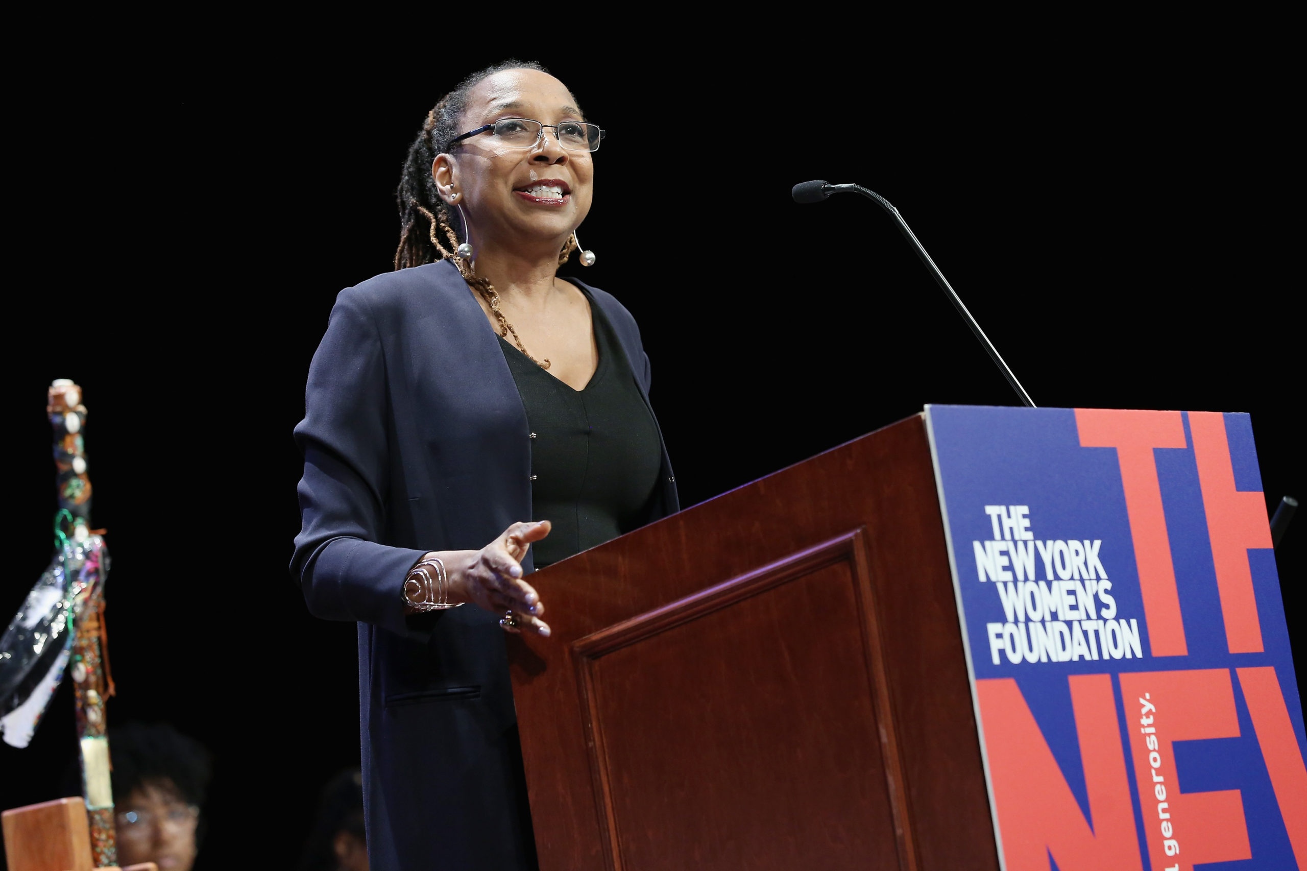 """NEW YORK, NY - MAY 10: Celebrating Women Award Honoree and co-founder and director of the African American Policy Forum, Kimberle Crenshaw speaks onstage during the New York Women's Foundation's 2018 """"Celebrating Women"""" breakfast on May 10, 2018 in New York City. (Photo by Monica Schipper/Getty Images for The New York Women's Foundation)"""