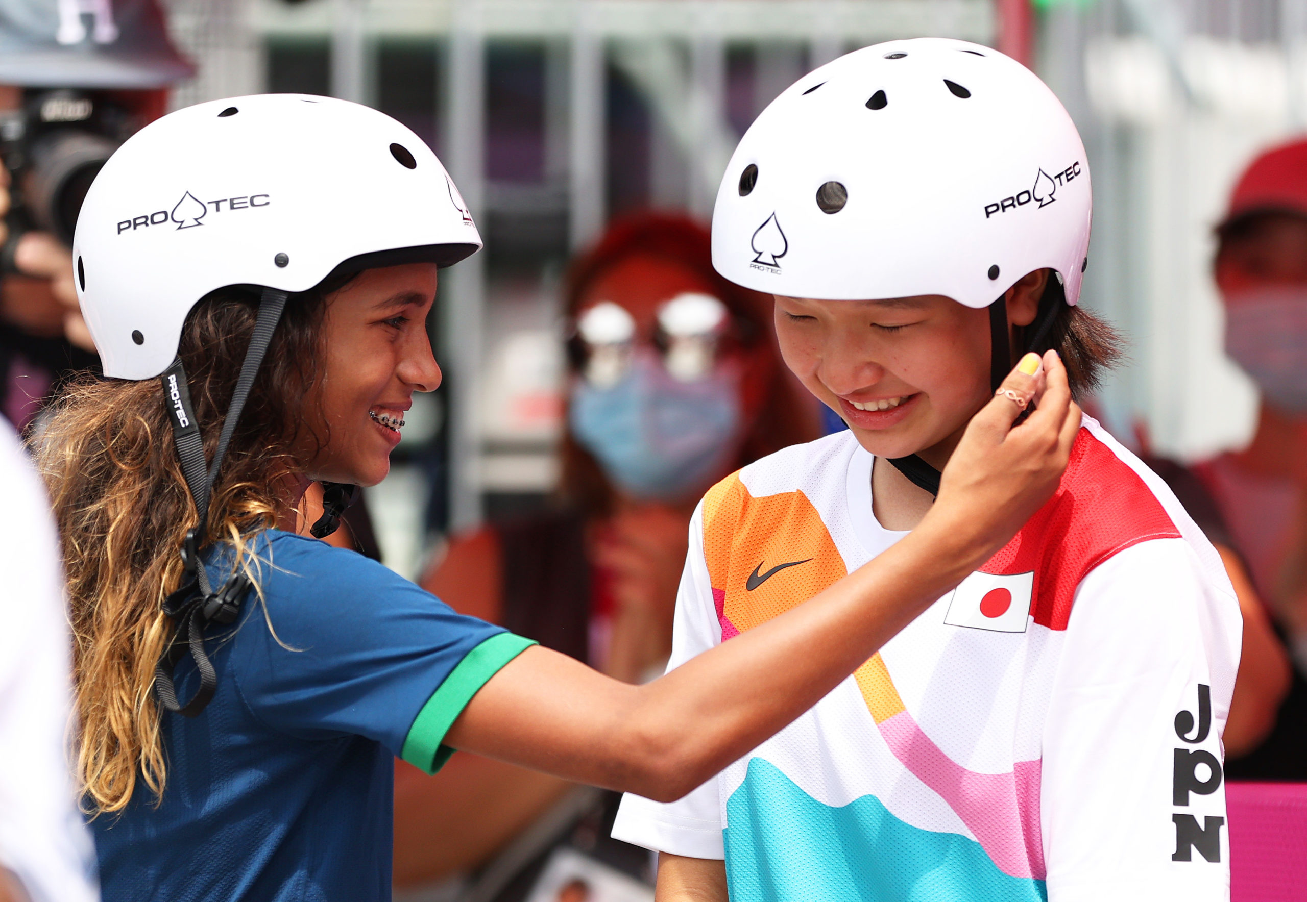 TOKYO, JAPAN - JULY 26: Rayssa Leal of Team Brazil puts her hand up to the face of Momiji Nishiya of Team Japan during the Women's Street Final on day three of the Tokyo 2020 Olympic Games at Ariake Urban Sports Park on July 26, 2021 in Tokyo, Japan. (Photo by Patrick Smith/Getty Images)