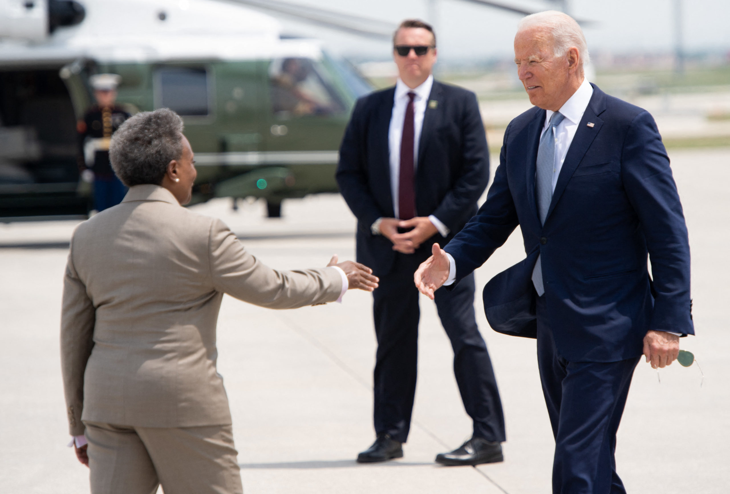 US President Joe Biden greets Chicago Mayor Lori Lightfoot as he disembarks from Air Force One upon arrival at O'Hare International Airport in Chicago, Illinois, July 7, 2021. (Photo by SAUL LOEB/AFP via Getty Images)