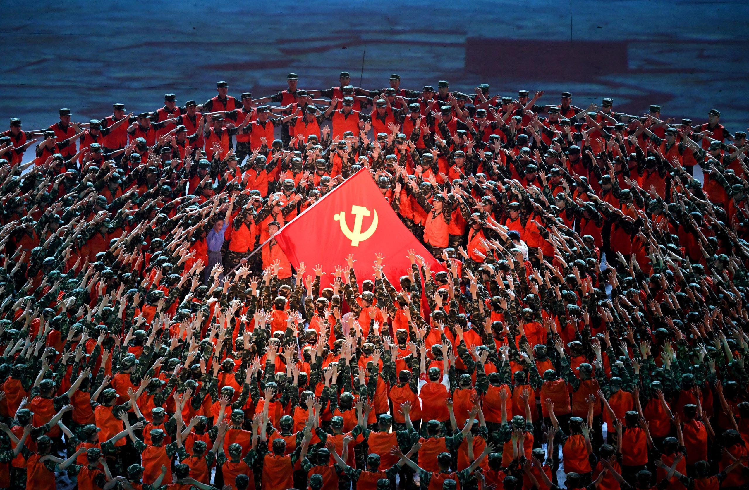 Performers dance during a Cultural Performance as part of the celebration of the 100th Anniversary of the Founding of the Communist Party of China. (Photo by NOEL CELIS/AFP via Getty Images)
