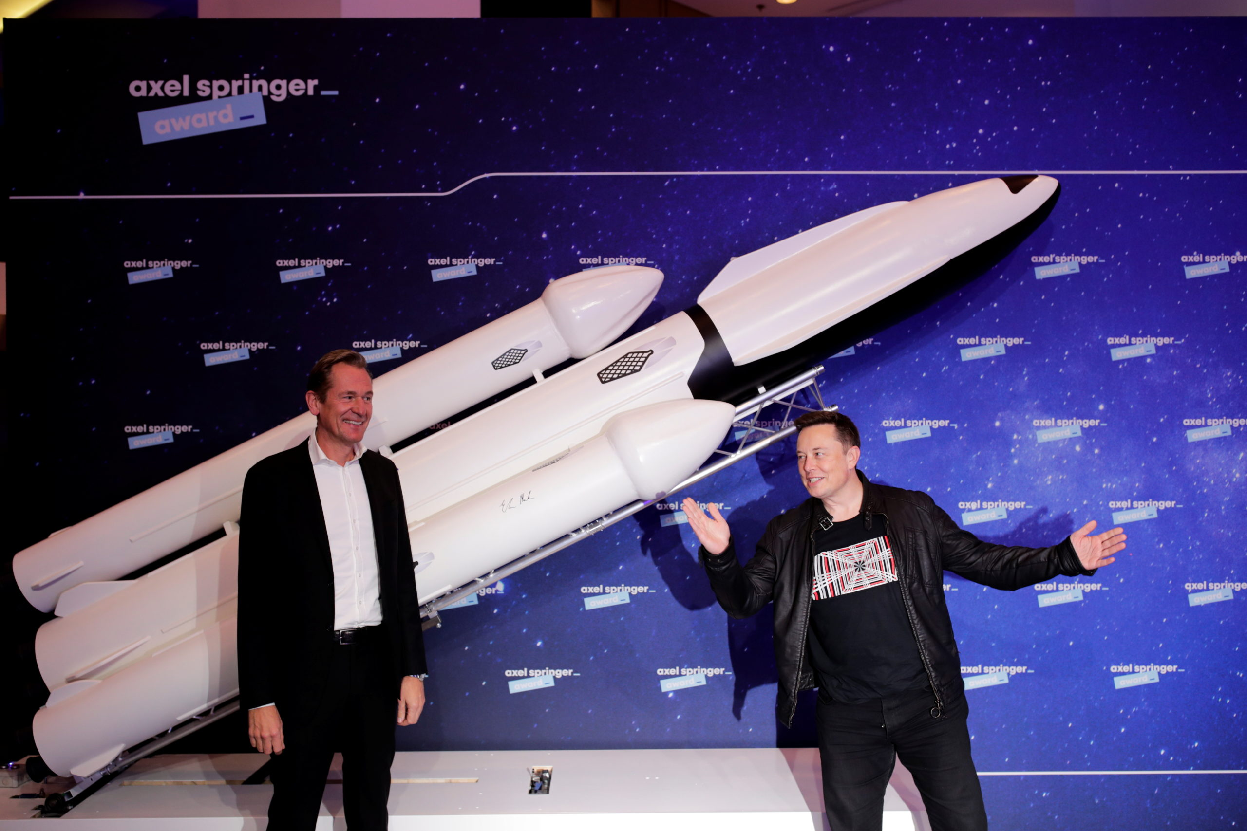 SpaceX owner and Tesla CEO Elon Musk poses next to Axel Springer's Chairman of the Board Mathias Doepfner. (Photo by Hannibal Hanschke-Pool/Getty Images)