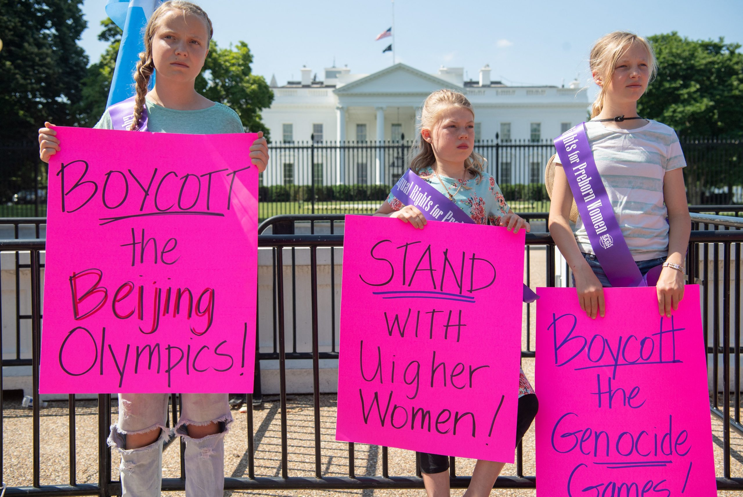 Young demonstrators with the group Stanton Public Policy Center's Purple Sash Revolution hold a rally in support of Uighur women and call to boycott the 2022 Olympic Games in Beijing during a protest at Lafayette Park outside the White House in Washington, DC, May 27, 2021. (Photo by SAUL LOEB/AFP via Getty Images)