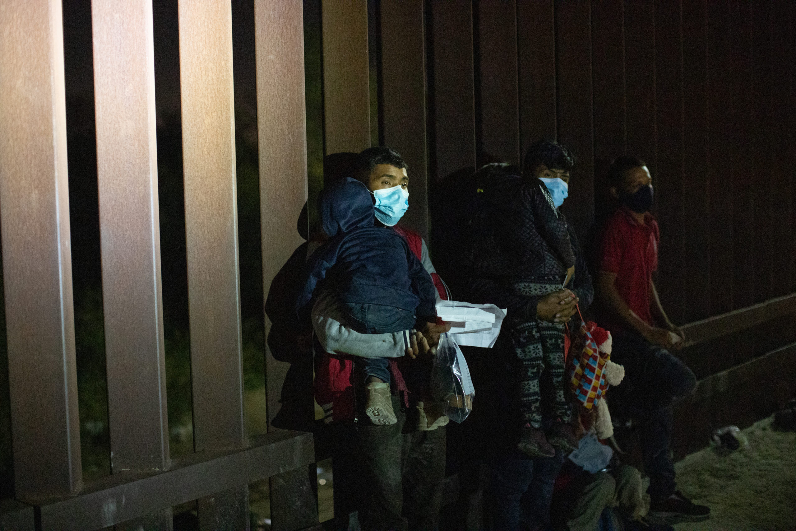 Migrants waited on a levee into the early morning to be processed by border officials after illegally entering the U.S. near the Hidalgo Point of Entry in Hidalgo, Texas, on. August 8, 2021. (Kaylee Greenlee - Daily Caller News Foundation)