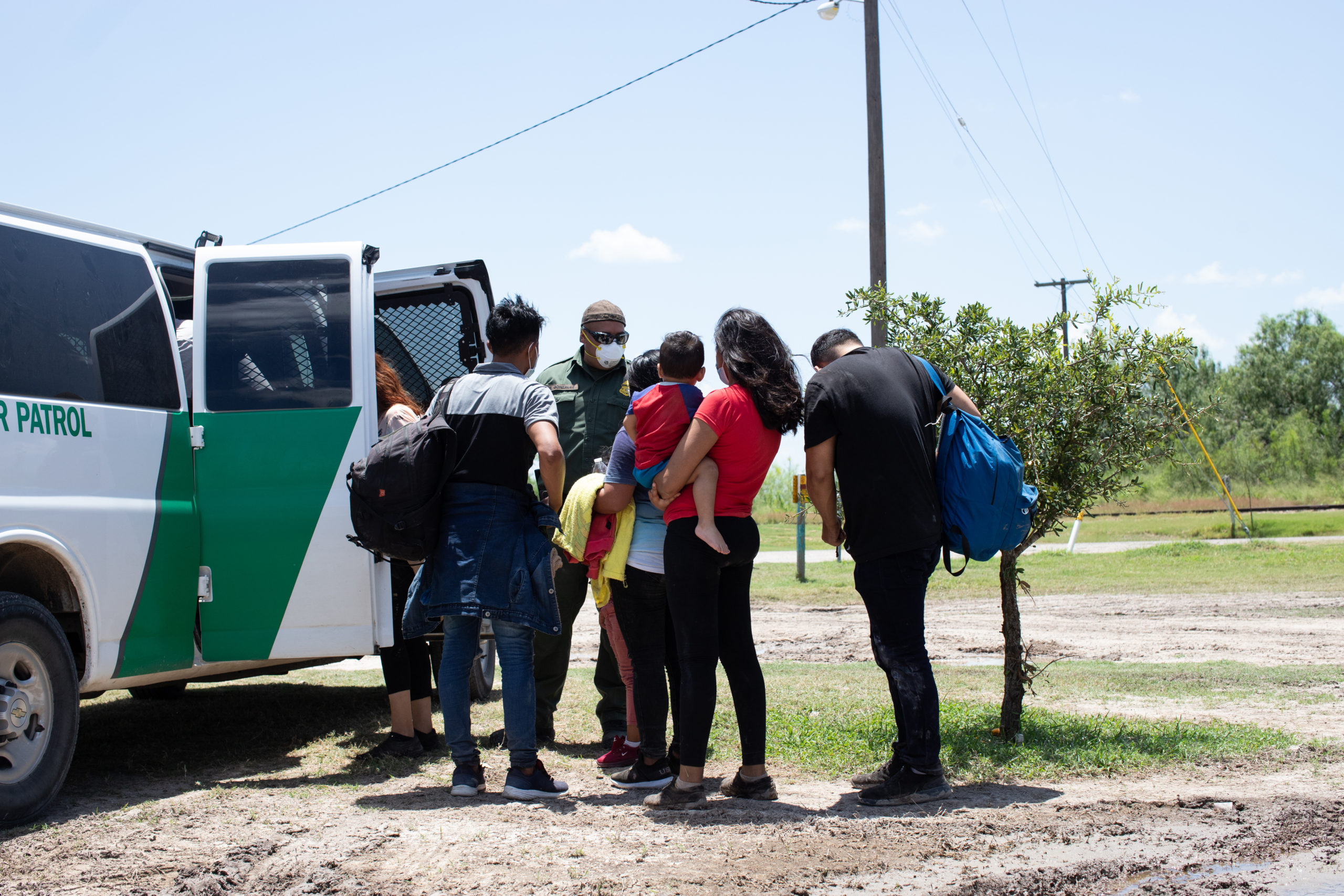 A group of migrants turned themselves in to Customs and Border Protection officials to be processed in hopes of applying for asylum near La Joya, Texas, on August 7, 2021. (Kaylee Greenlee - Daily Caller News Foundation)