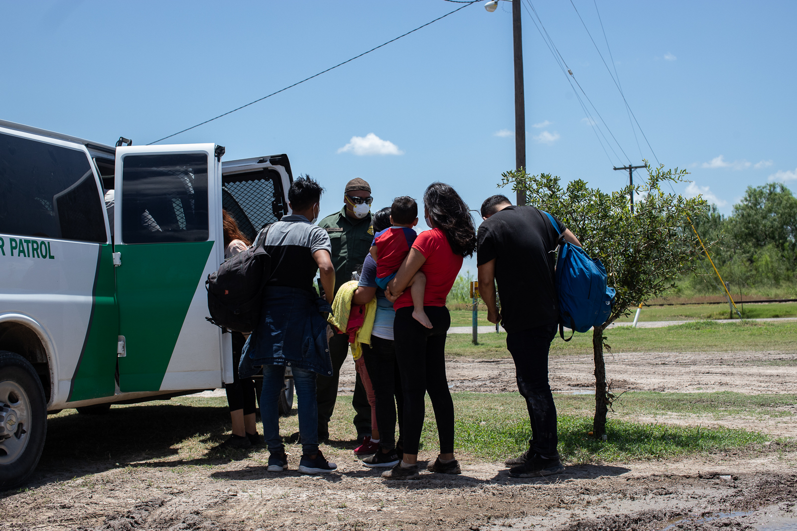 Migrants make their way to a Border Patrol transport vehicle after illegally entering the U.S. near La Joya, Texas, on August 7, 2021. (Kaylee Greenlee - Daily Caller News Foundation)
