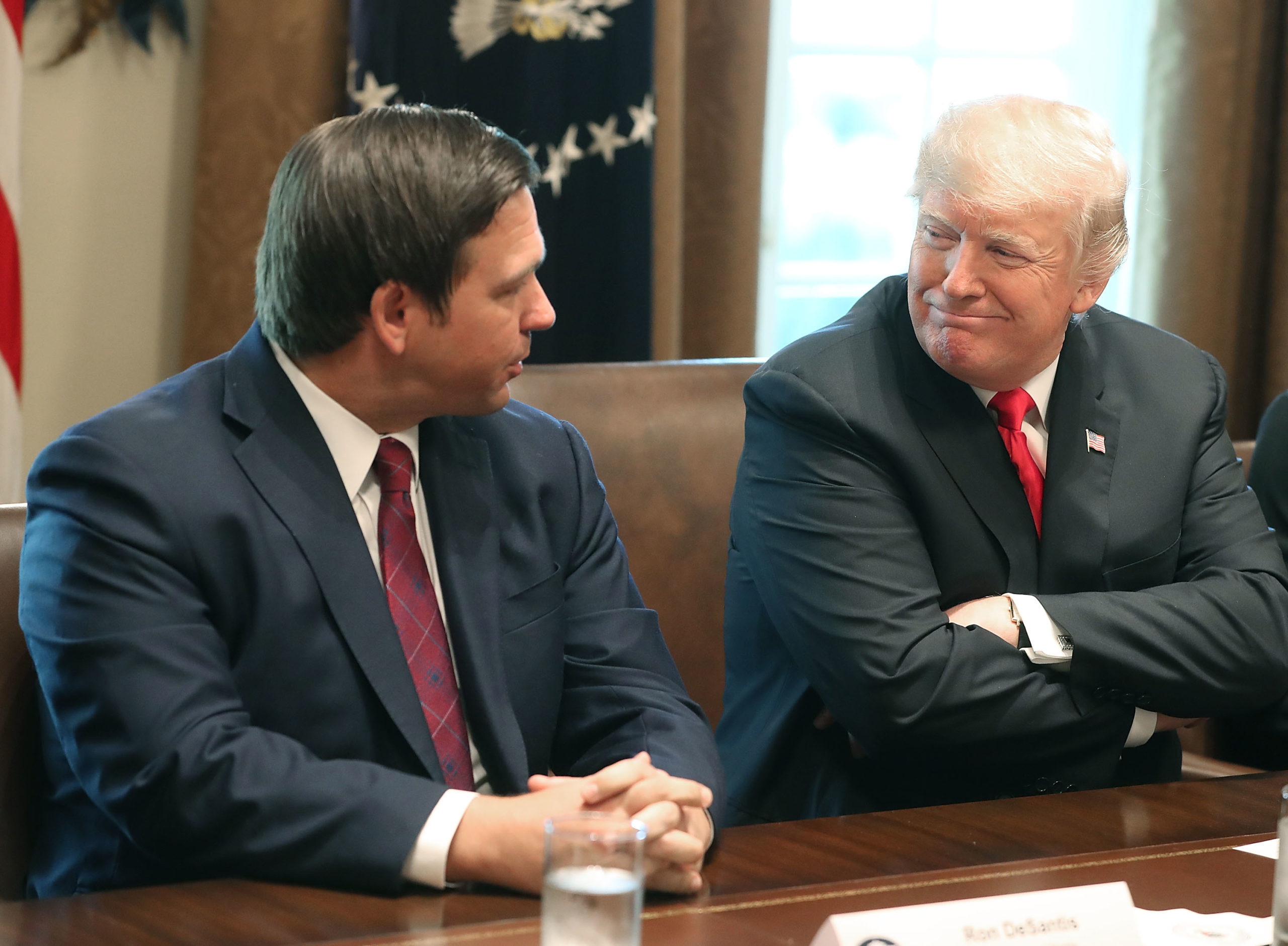 WASHINGTON, DC - DECEMBER 13: Florida Governor-elect Ron DeSantis (R) sits next to U.S. President Donald Trump during a meeting with Governors elects in the Cabinet Room at the White House on December 13, 2018 in Washington, DC. (Photo by Mark Wilson/Getty Images)