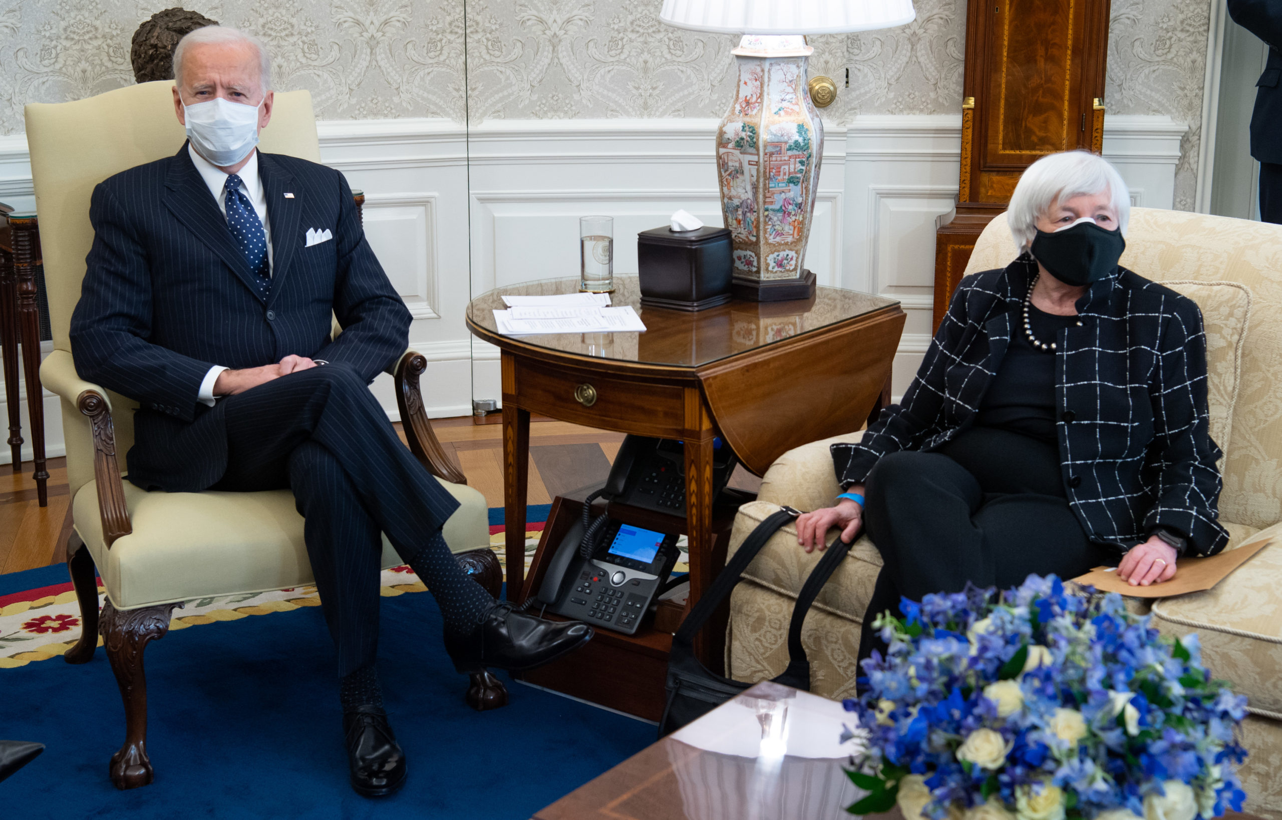 US President Joe Biden sits alongside US Treasury Secretary Janet Yellen (R) as he holds a meeting with business leaders about a Covid relief bill in the Oval Office of the White House in Washington, DC, February 9, 2021. (Photo by SAUL LOEB / AFP) (Photo by SAUL LOEB/AFP via Getty Images)