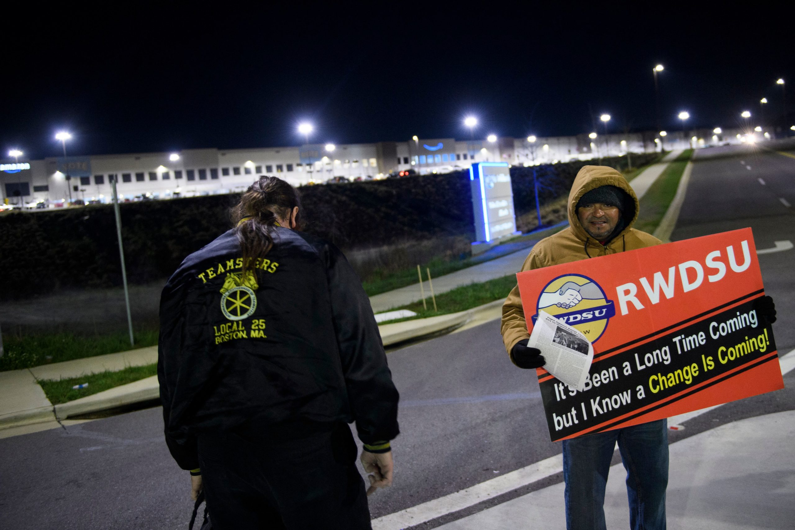 Union supporters distribute information outside the Amazon fulfillment center in Bessemer, Alabama on March 29. (Patrick T. Fallon/AFP via Getty Images)