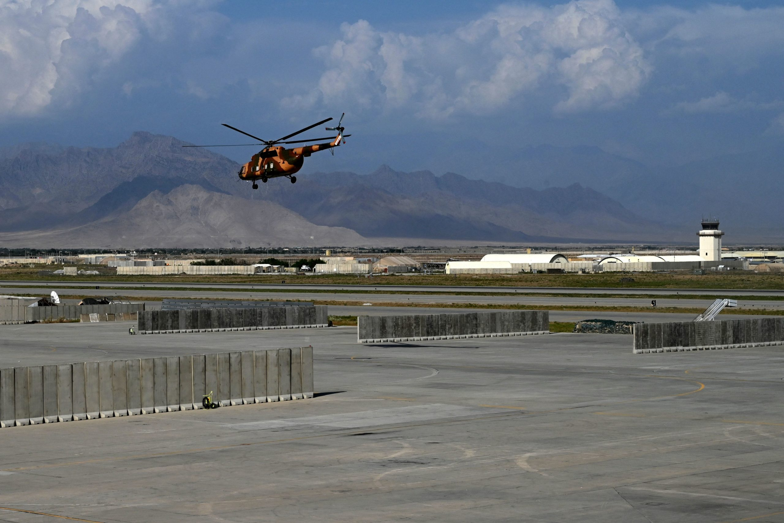 An Afghan National Army (ANA) helicopter takes off inside the Bagram US air base after all US and NATO troops left, some 70 Kms north of Kabul on July 5, 2021. (Photo by WAKIL KOHSAR / AFP) (Photo by WAKIL KOHSAR/AFP via Getty Images)