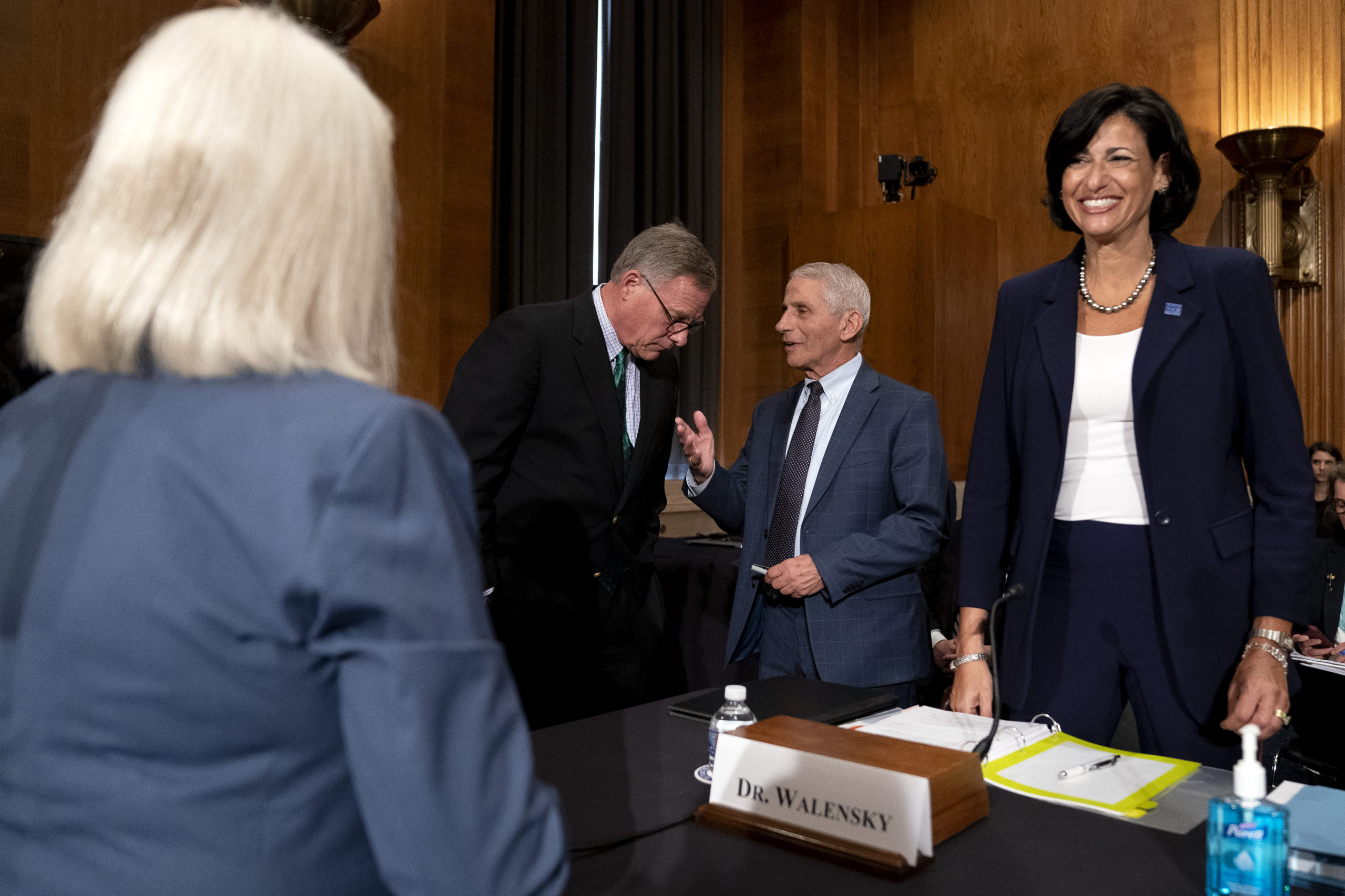 Senators meet with Dr. Anthony Fauci and CDC Director Rochelle Walensky before a hearing on July 20. (Stefani Reynolds/Pool/Getty Images)